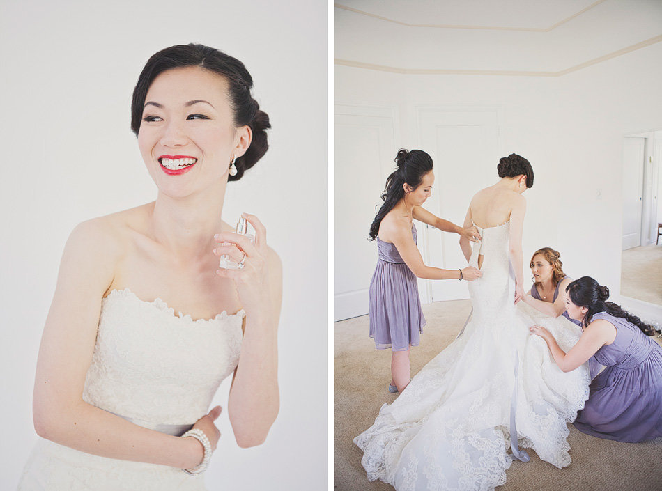 bride getting dressed with the help of her bridesmaids