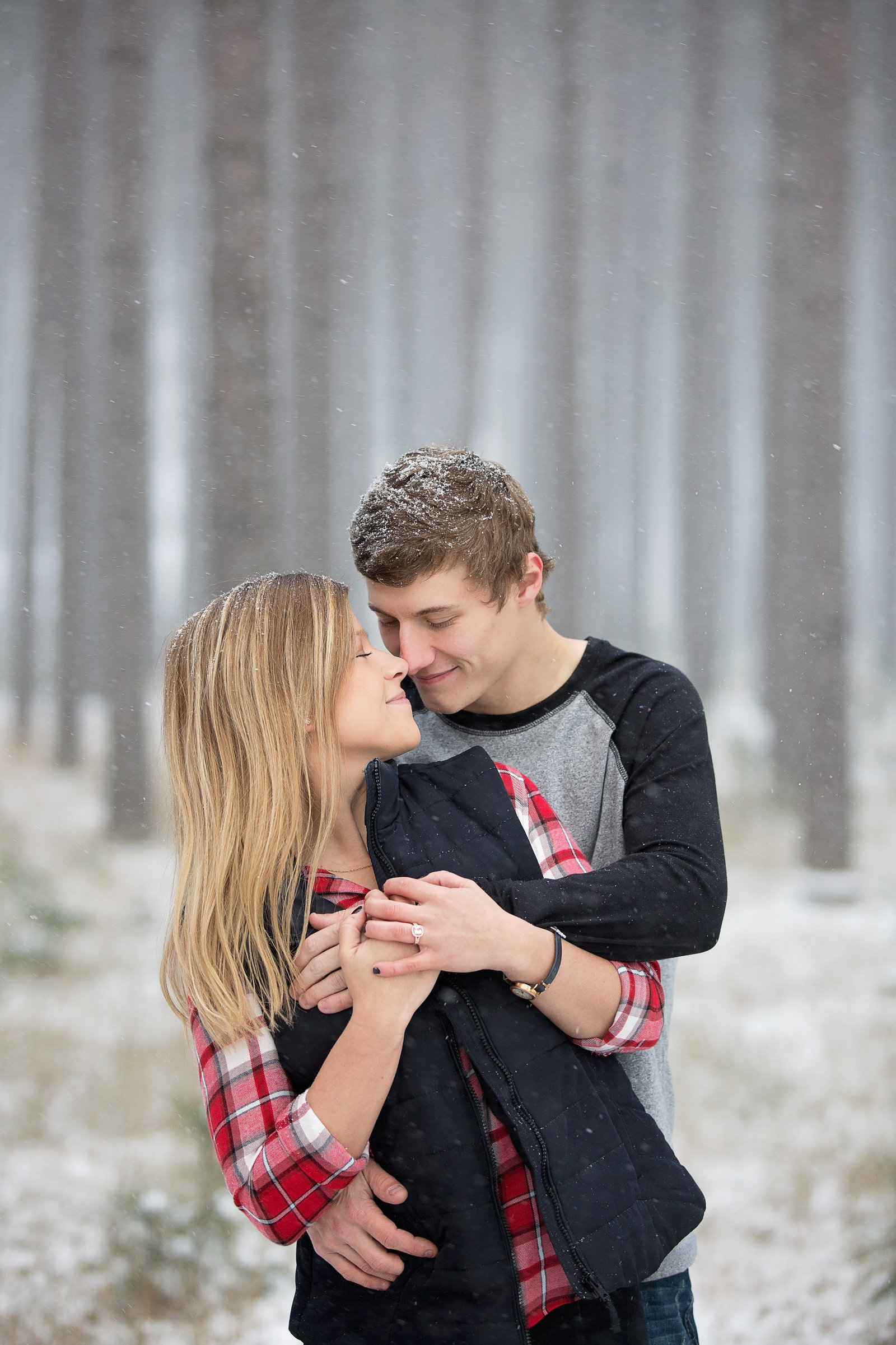 Winter engagement in Kingsford, MI with http://www.photosbyciera.com
