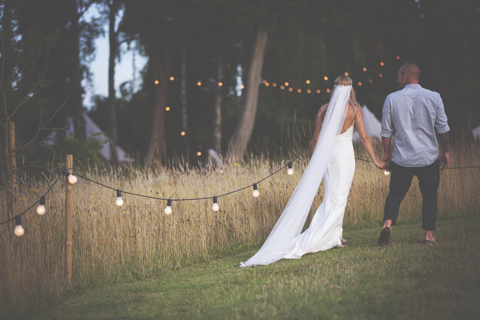 Bride and Groom walking holding hands at The Keeper and the Dell Norfolk