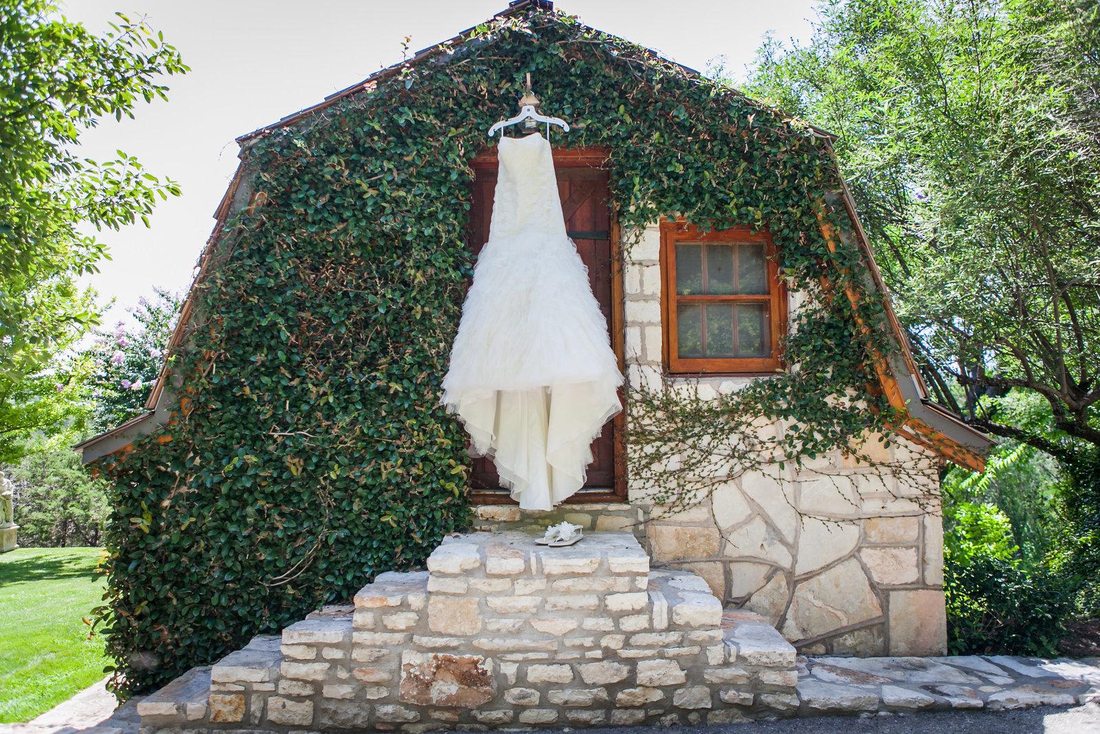 Austin Family Photographer, Tiffany Chapman, bride's dress hanging on barn  photo