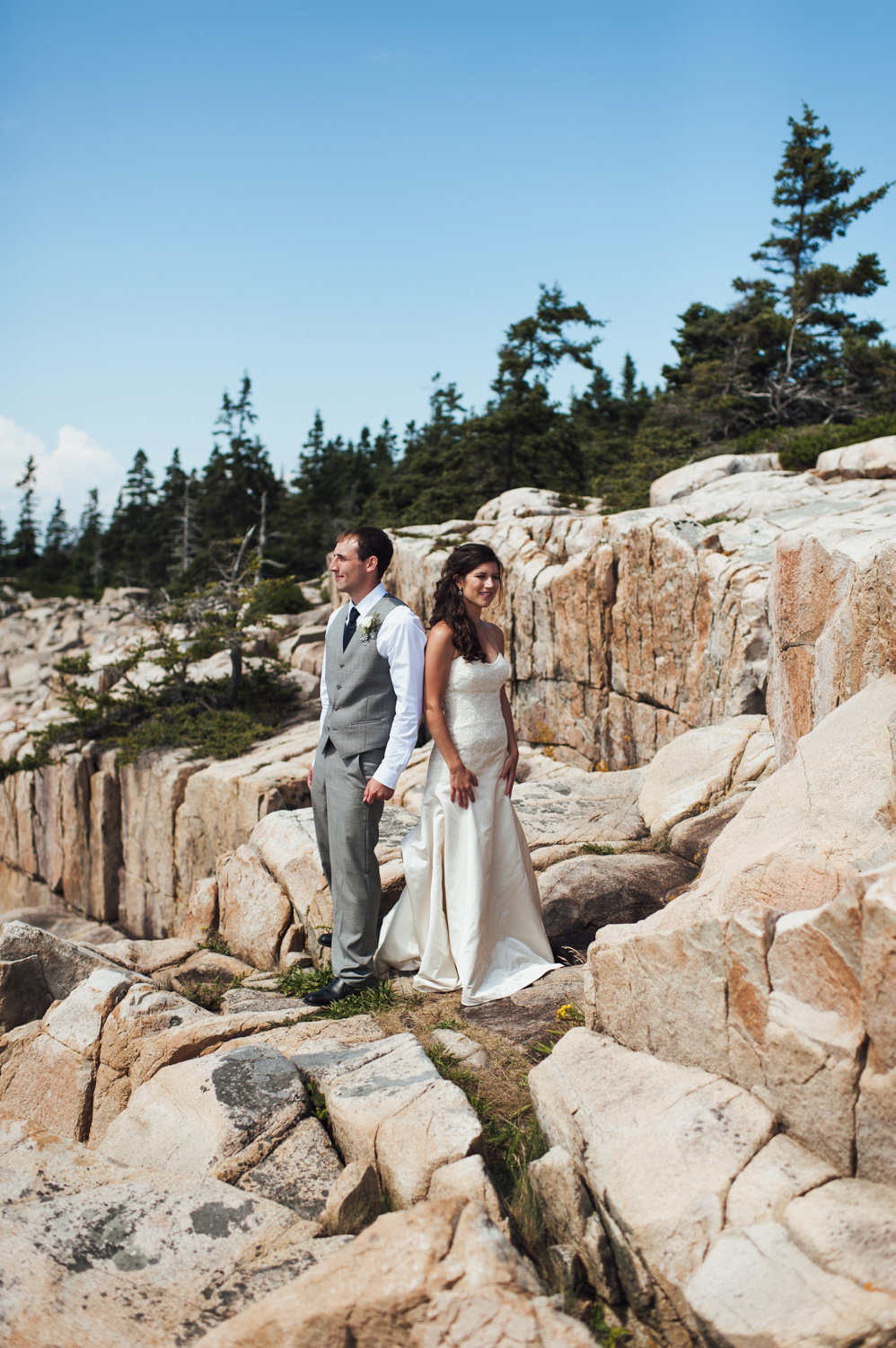 Bride and groom exploring acadia national park
