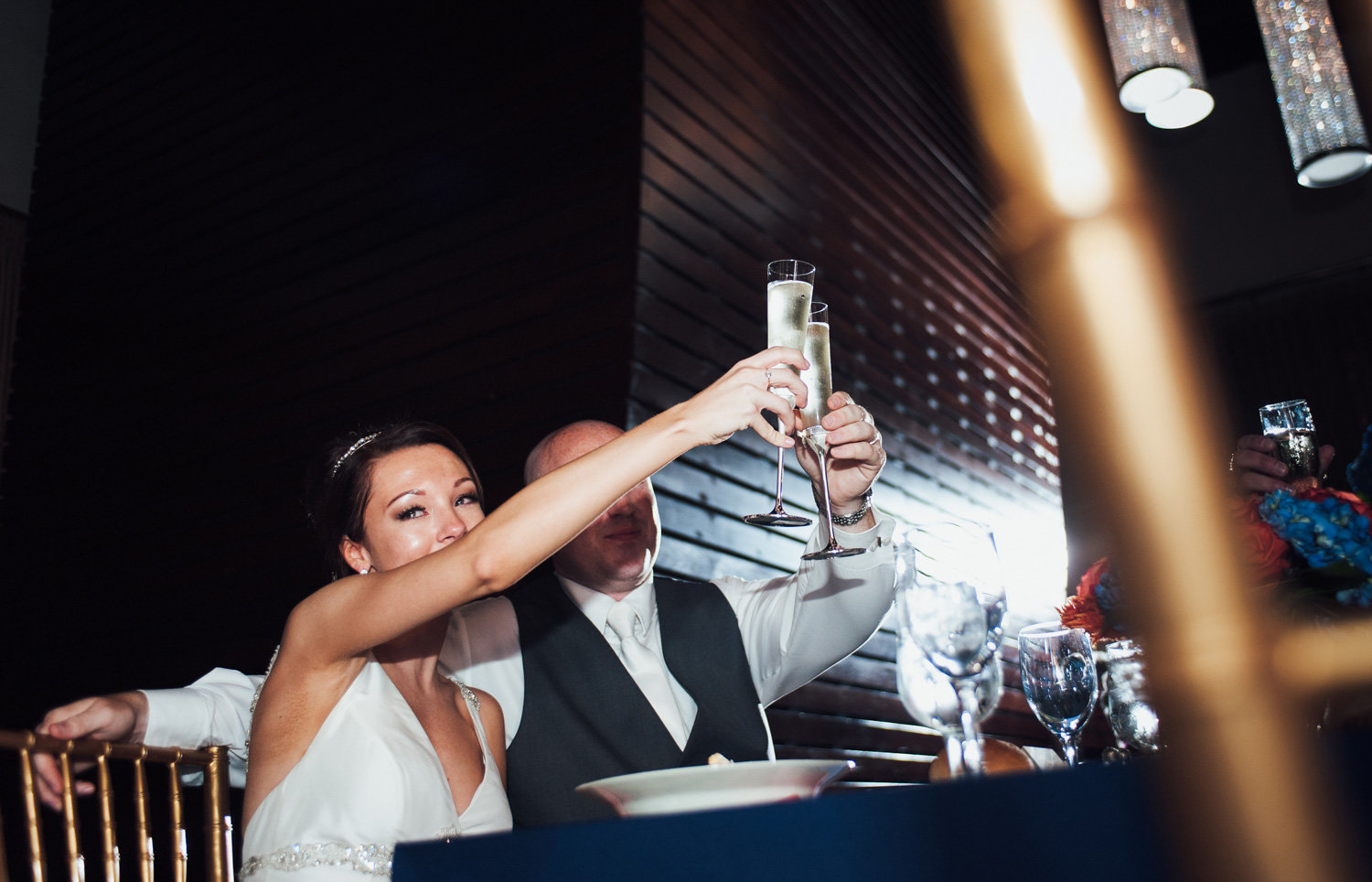 Bride and groom cheers at their wedding reception at the phoenixville foundry
