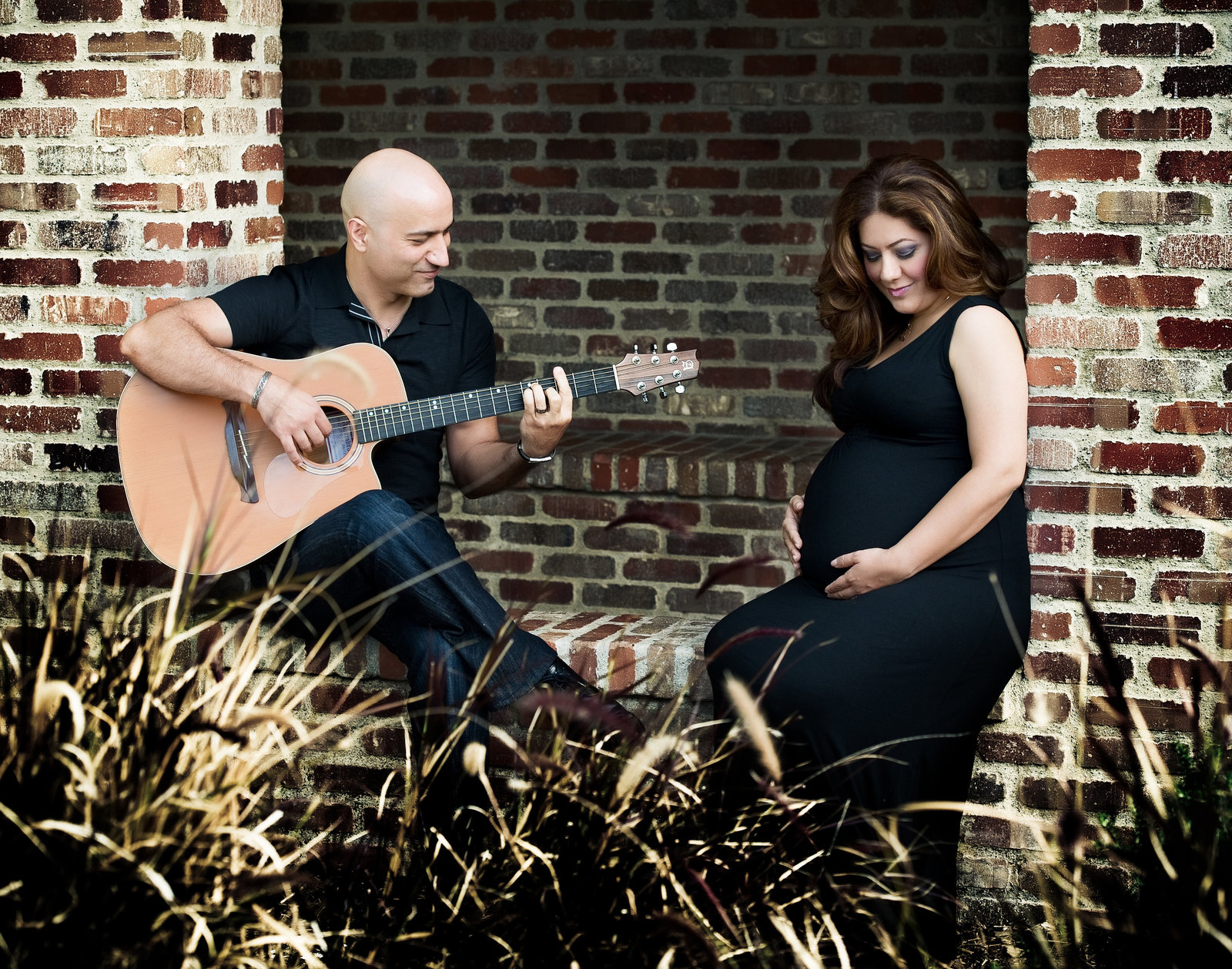 expectant dad playing guitar to pregnant mom
