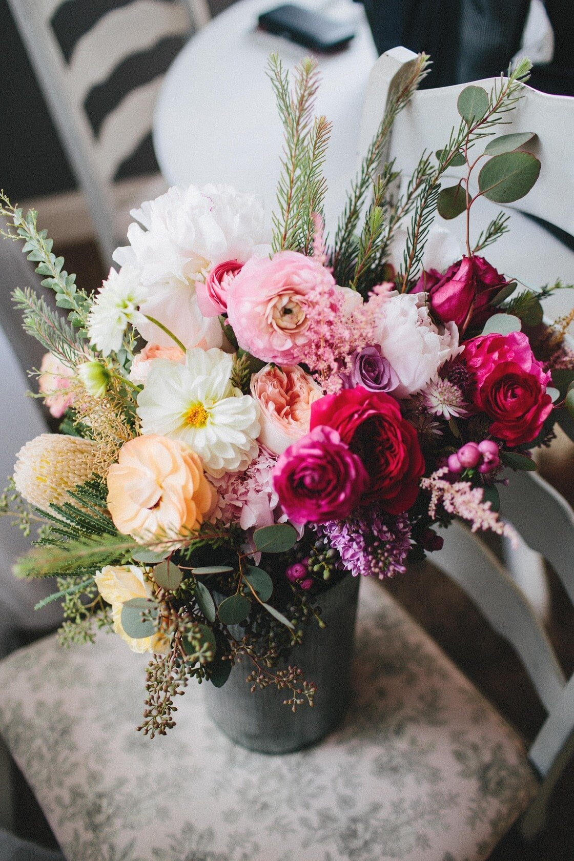 bridal-flowers-in-bucket-on-chair