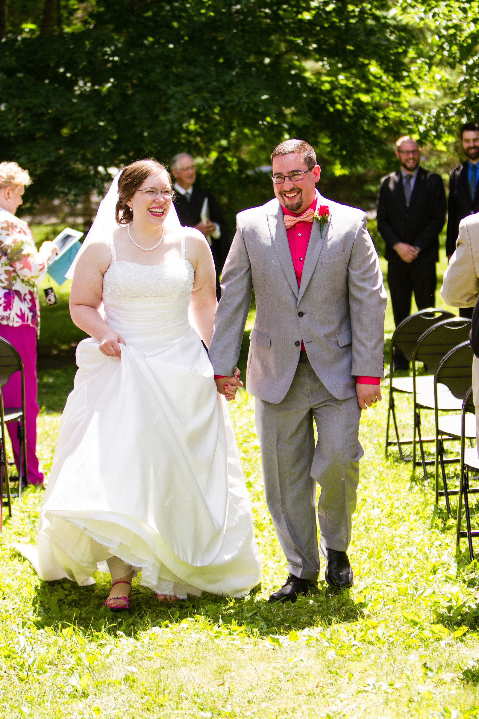 wedding photography bride and groom walking down aisle