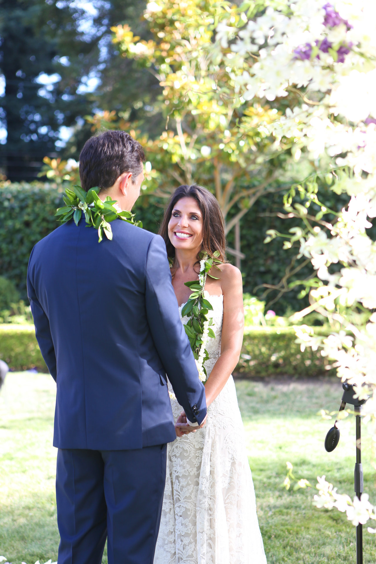 In stunning atherton wedding, bride and groom pose for a natural light portrait