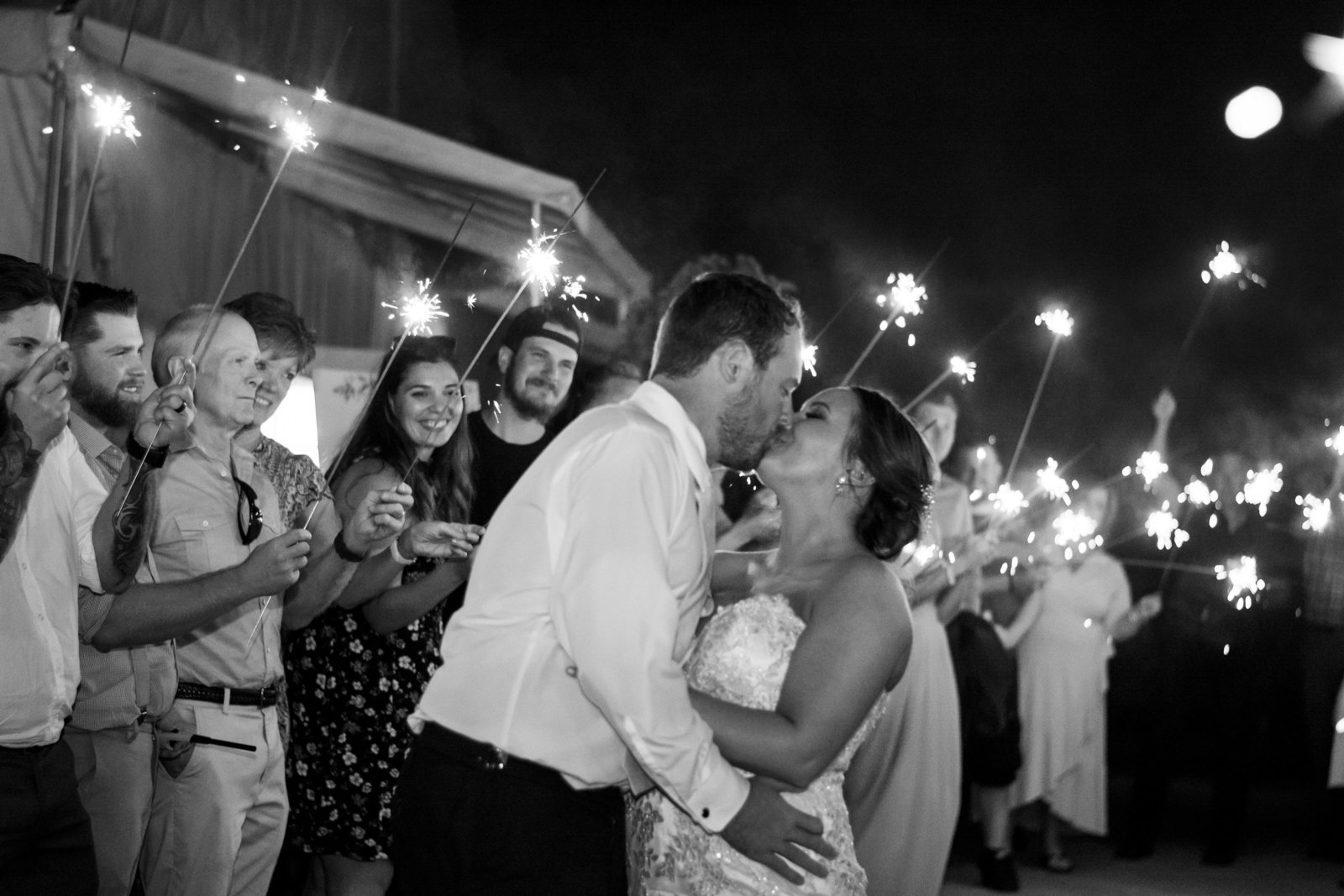 Black and white photo with bride and groom and sparklers