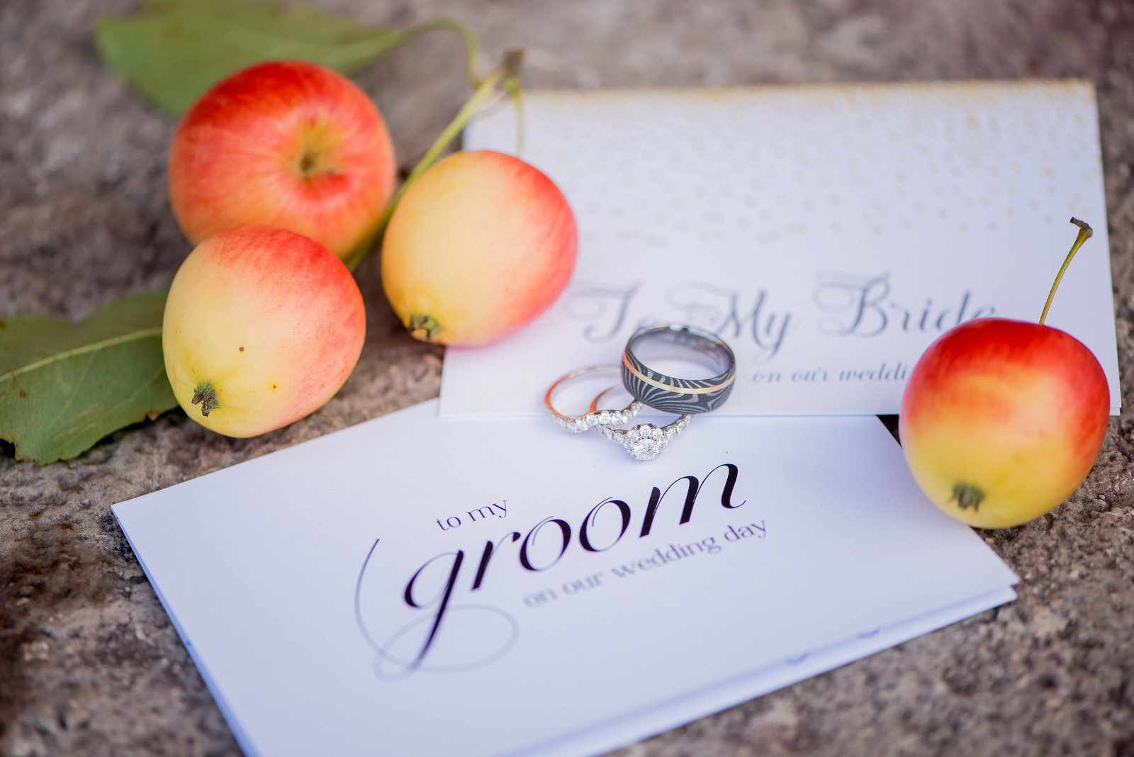 Bride and groom letters and rings photographed by Kris Kandel. Apples and fall details at the bluestem event center.