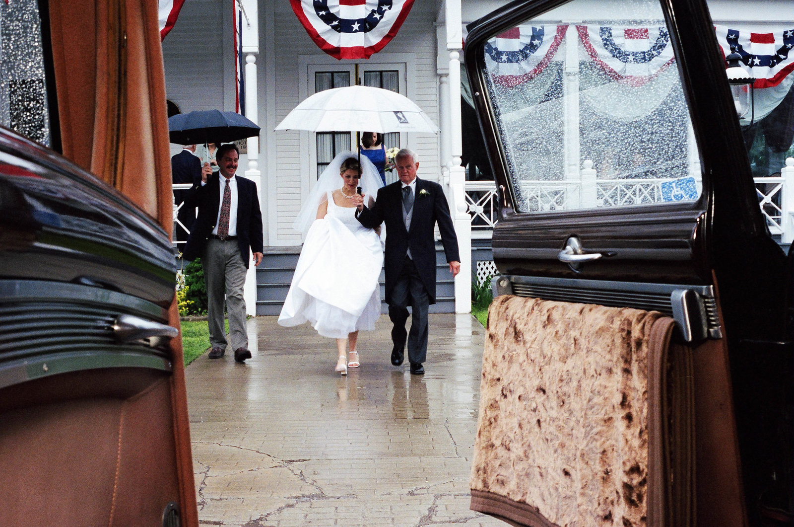 bride escorted to car by dad
