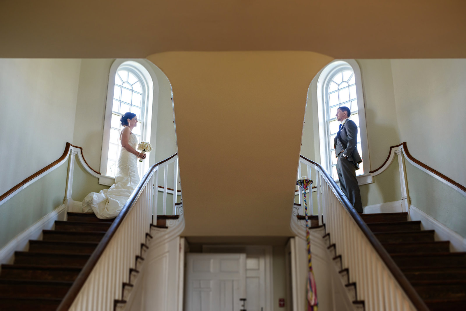 A couple have their first look at the top of the stairs.
