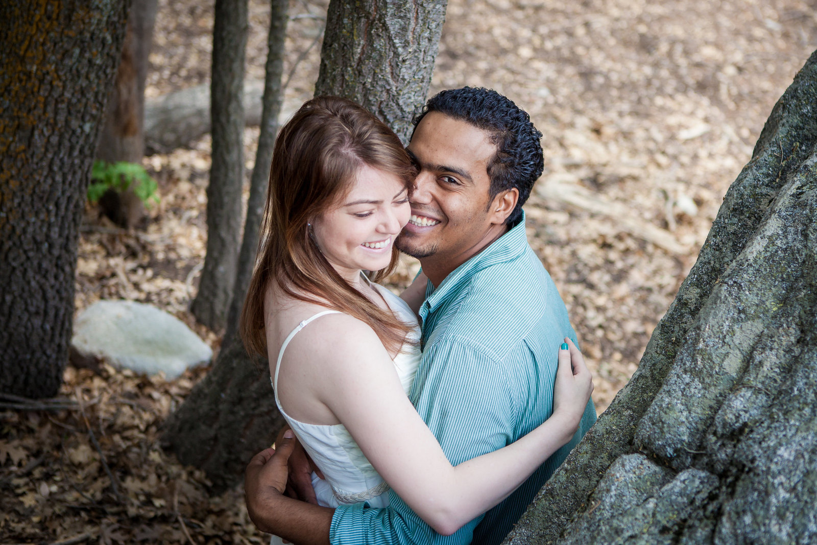 Idyllwild CA Engagement session couple snuggling under trees