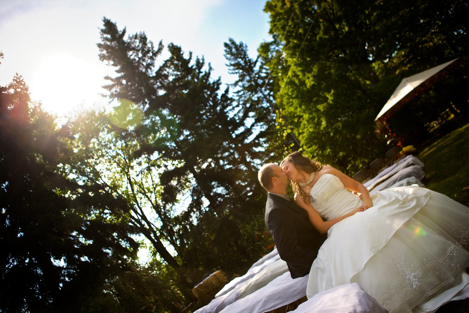 Central Minnesota country outdoor wedding.  Kissing couple!