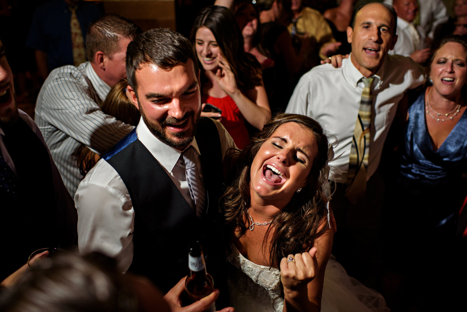 A bride and groom singing their hearts out to the last song at their reception at the Union Trust in Philadelphia.