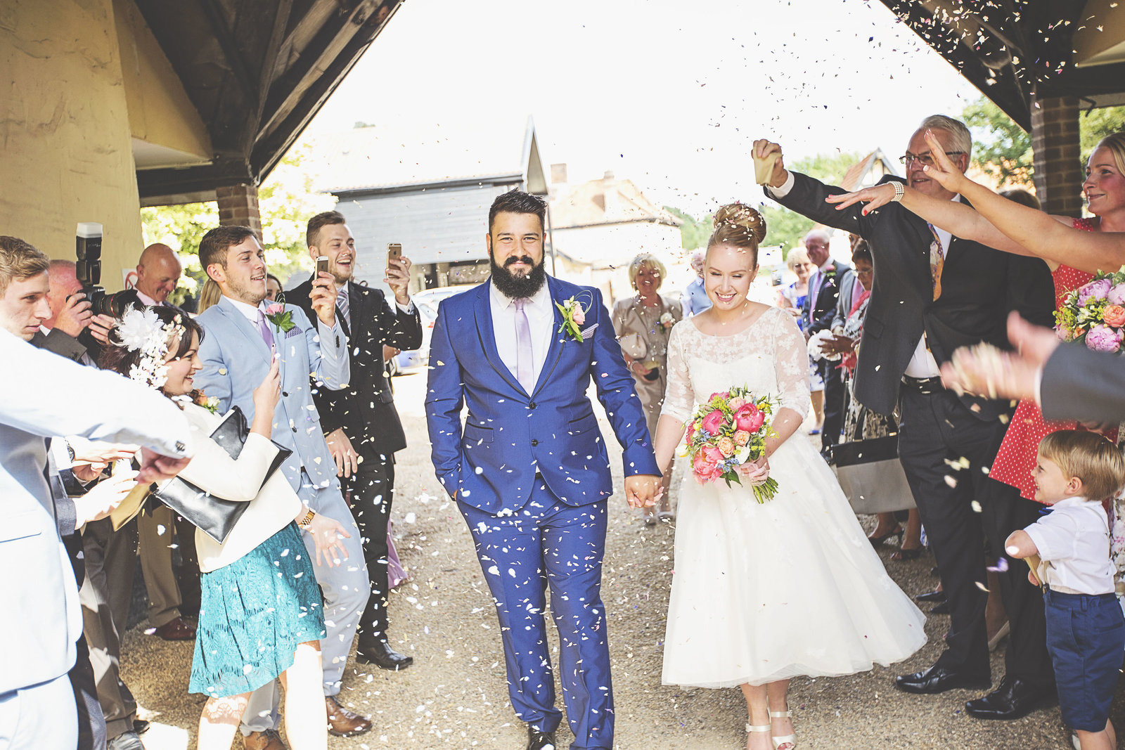 Norfolk bride and groom having their confetti moment at Norfolk venue