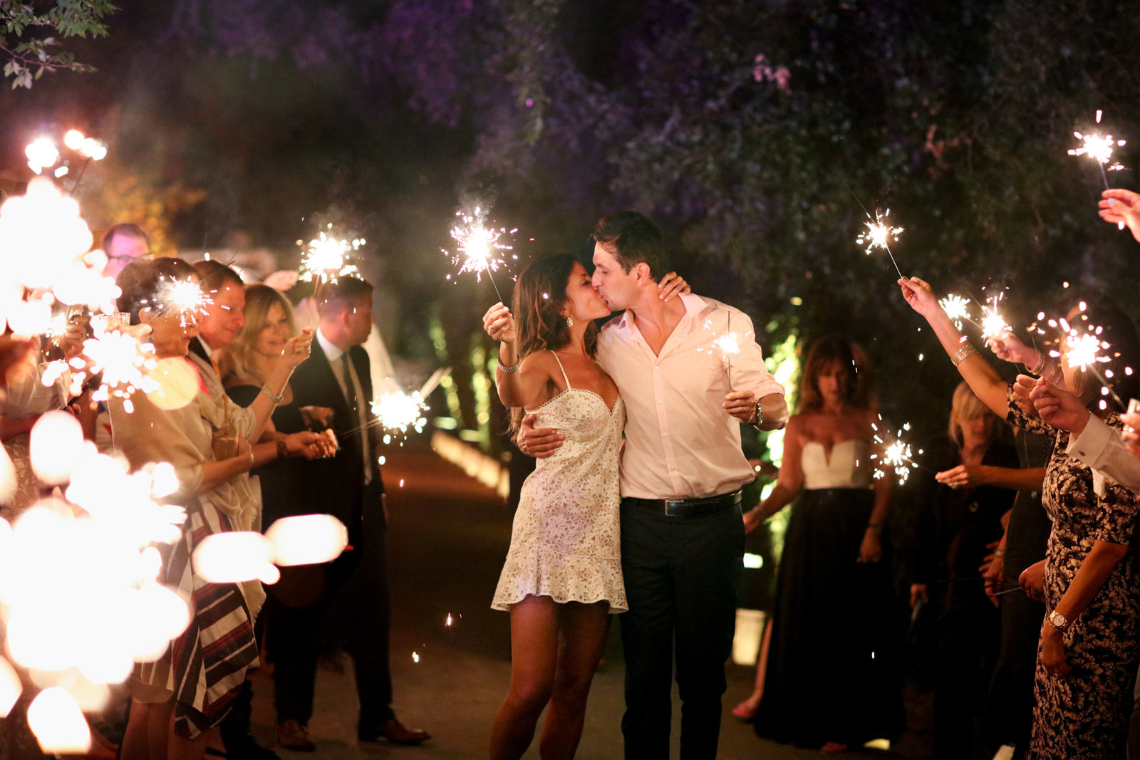Sparklers surround bride and groom in beautiful atherton wedding