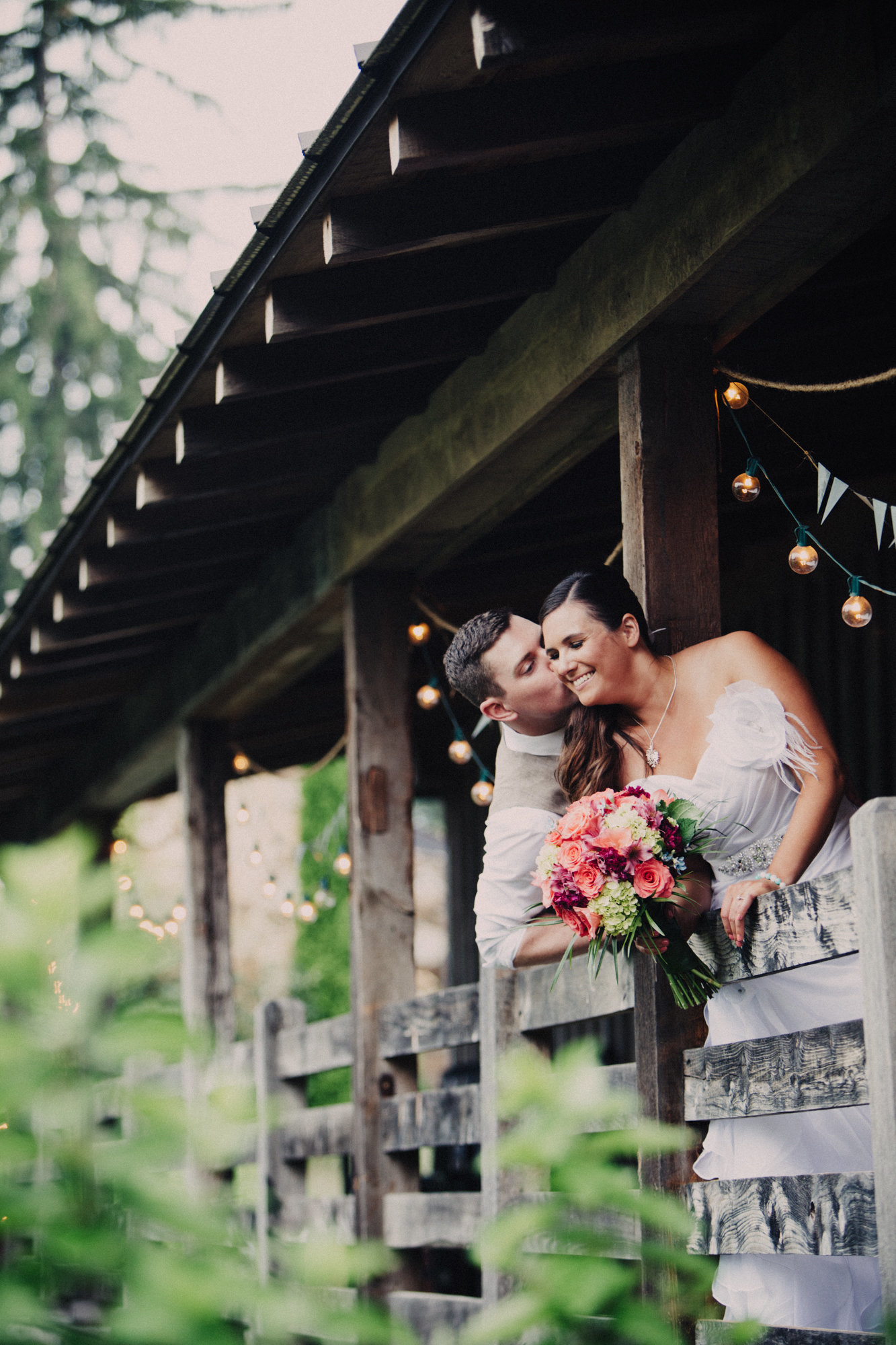 a couple poses at a vineyard for their wedding
