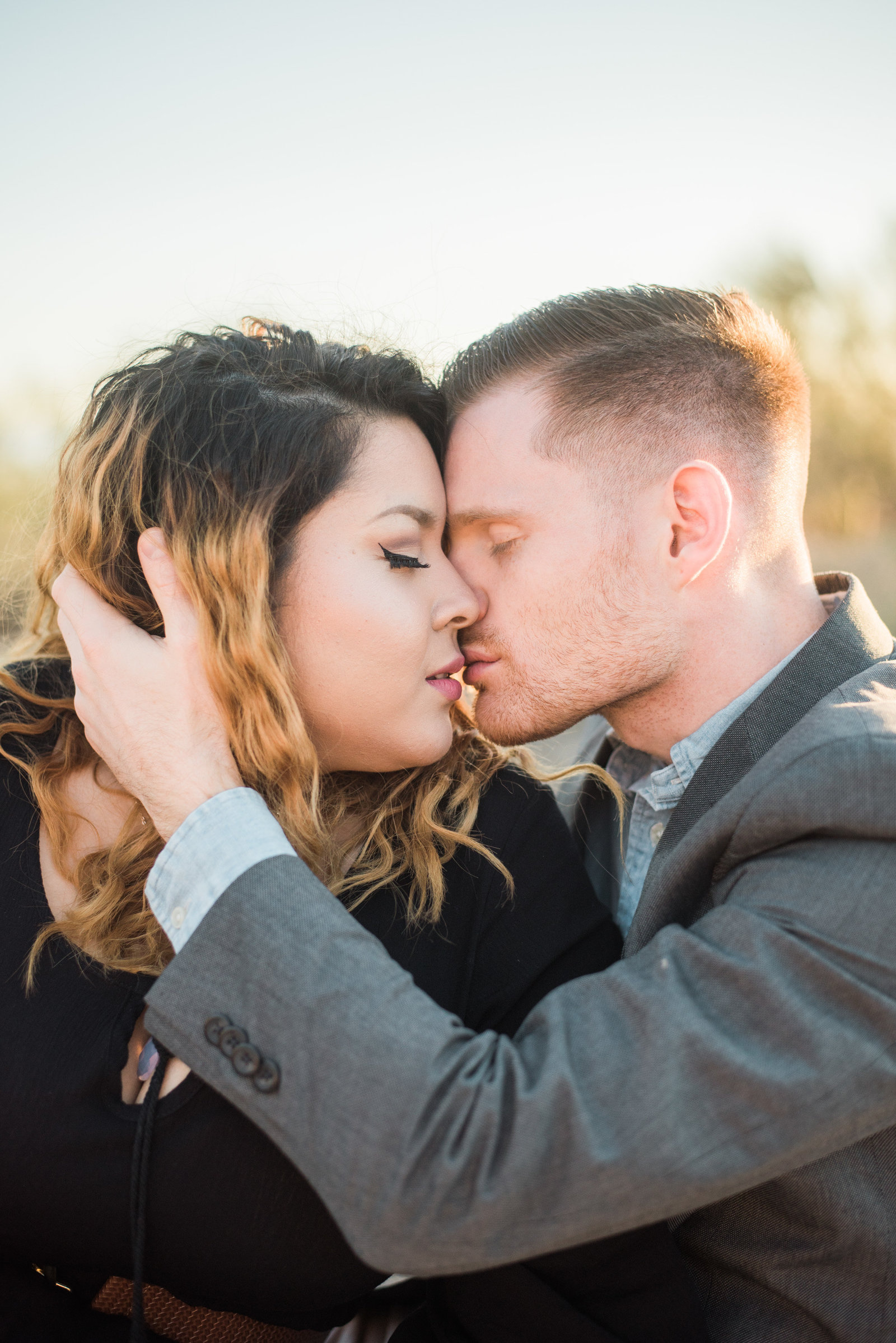 Gates Pass Tucson desert engagement session of bride and groom kissing