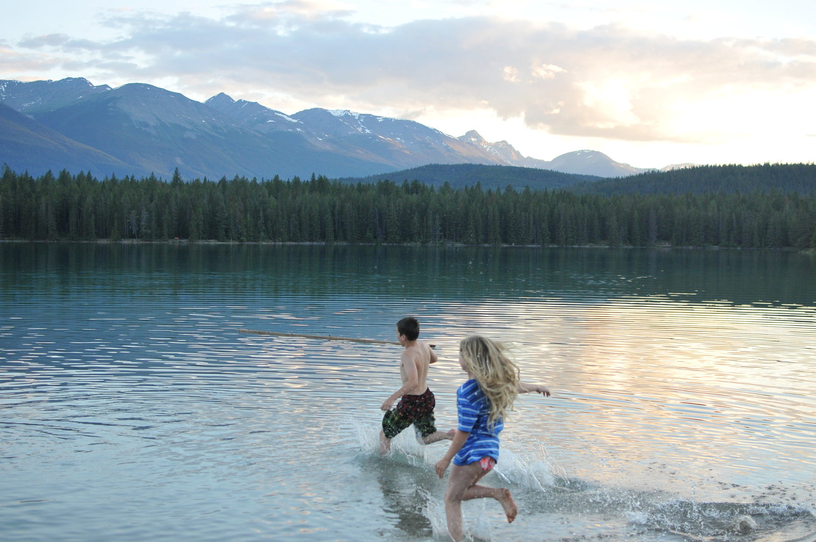 Travel Alberta Jasper Mountains Vacation Kids running into the water by Melissa E Earle Mee
