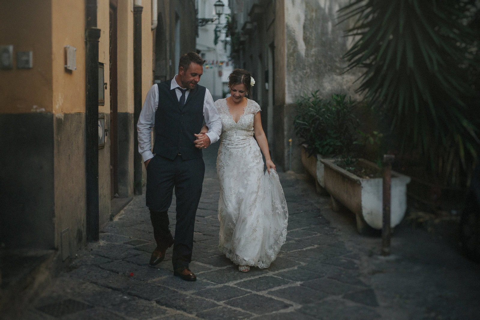 Newly married couple walking hand in hand through the streets of Sorrento, Italy by Sorrento Wedding Photographer Jono Symonds