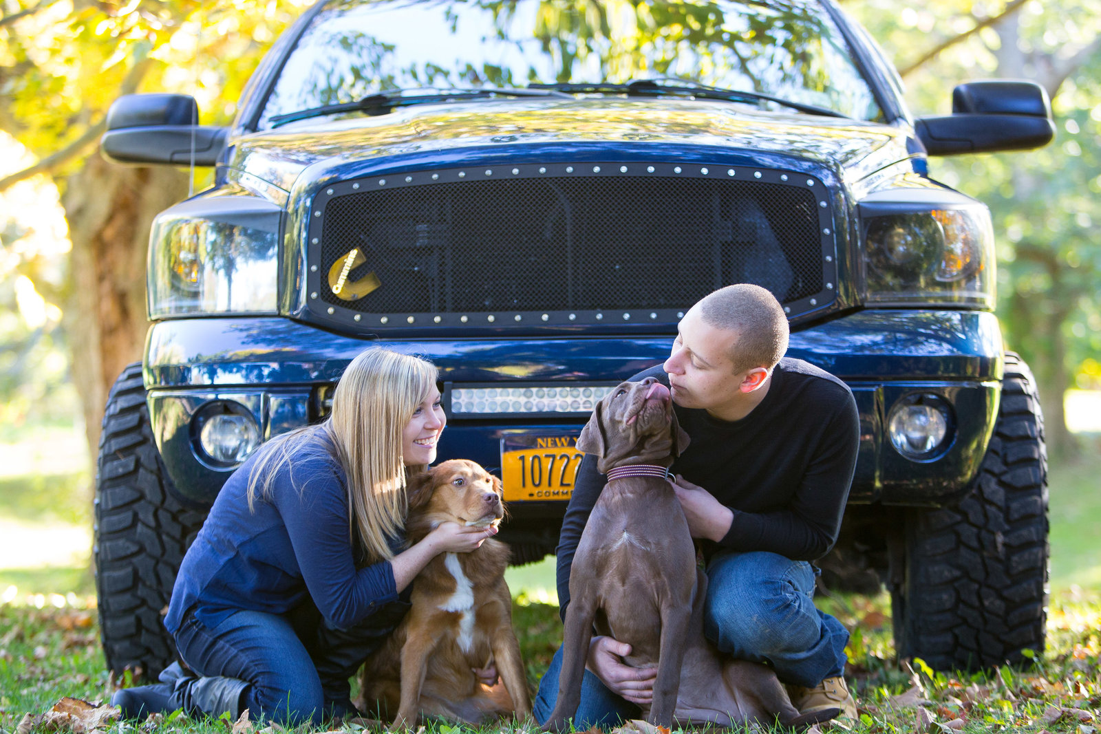 engagement photo with two dogs