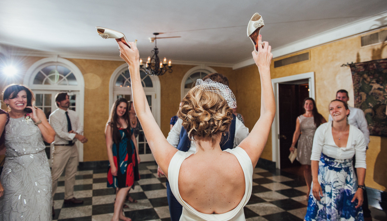 bride takes off shoes during dancing at brantwyn estates
