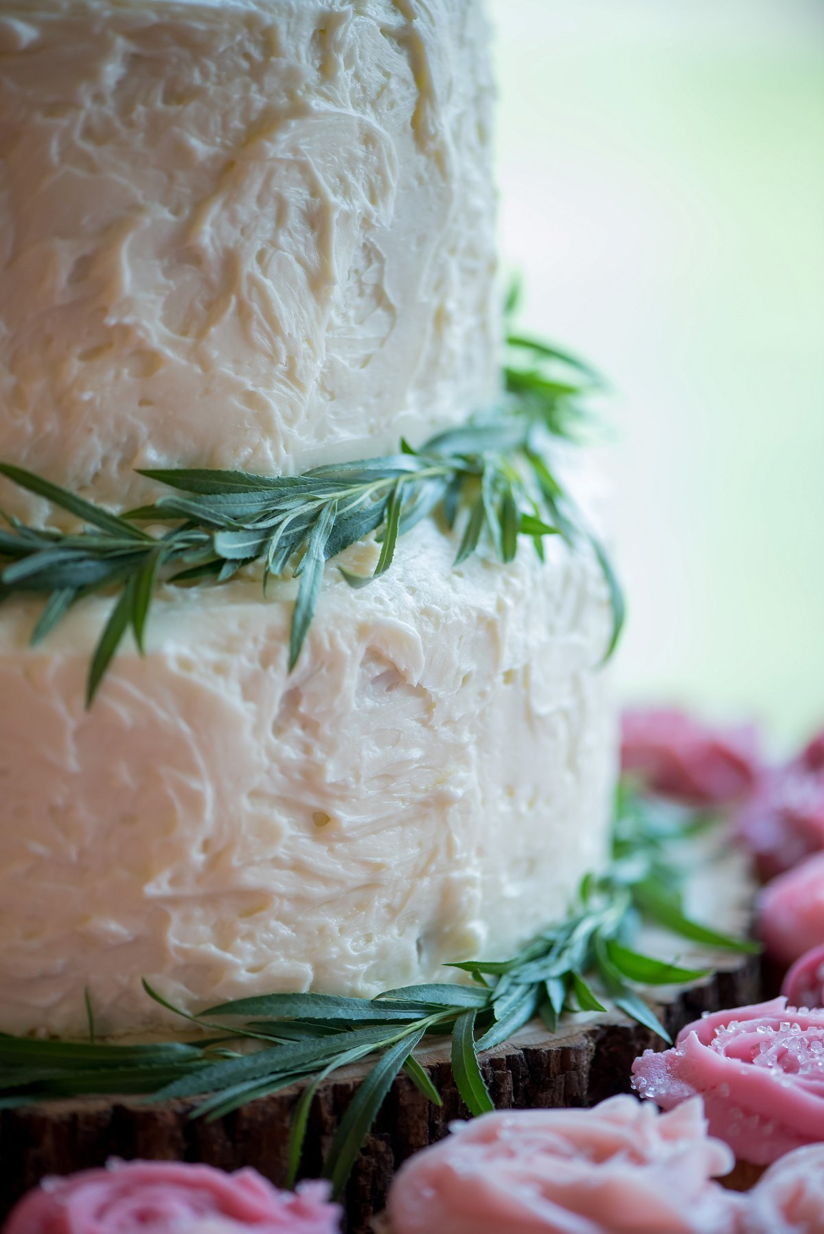 Sage and cream wedding cake, simple boho wedding cakes, greenery. Photo by Kriskandel