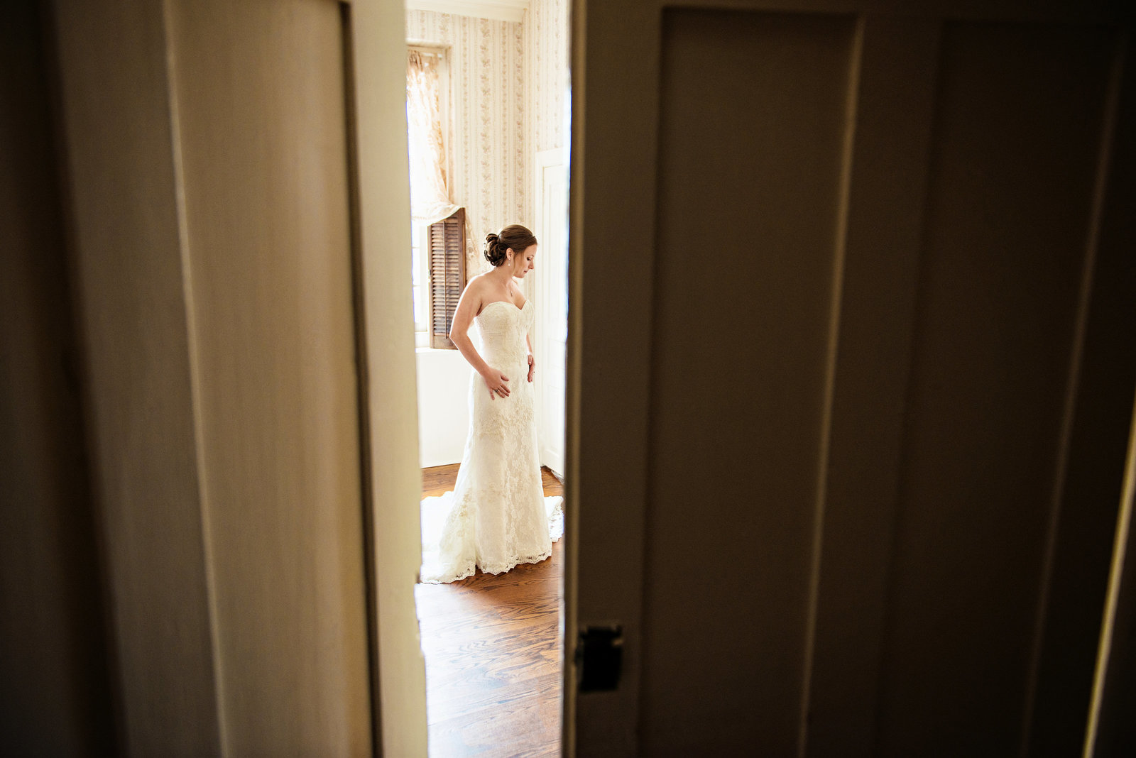 A peak through the door of a bride getting ready for her wedding at the Rosebank Winery.