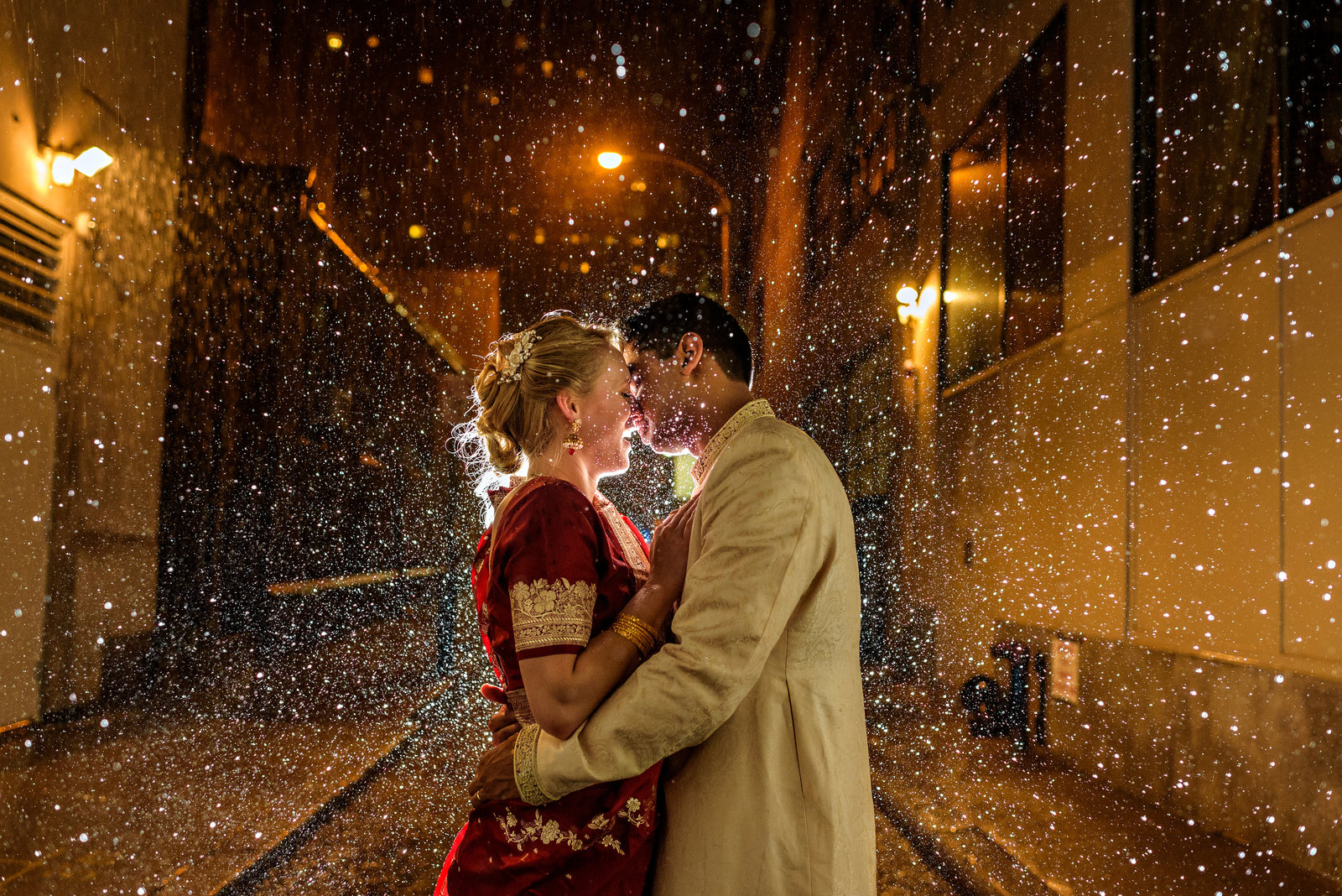 Indian wedding couple caught in the rain after their reception at the Racquet Club of Philadelphia.