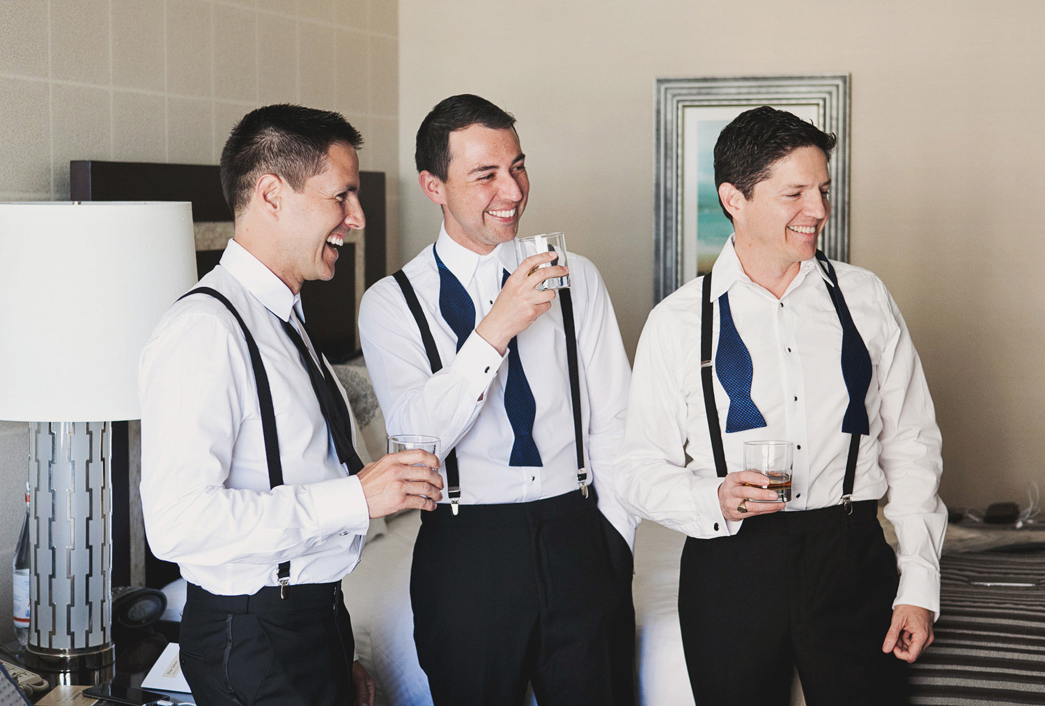 Groomsmen getting ready with black bow ties