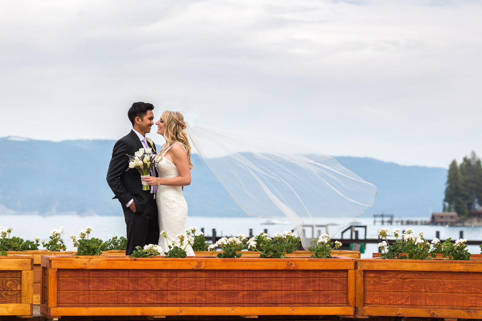 san francisco wedding photography couple on dock with veil in the wind