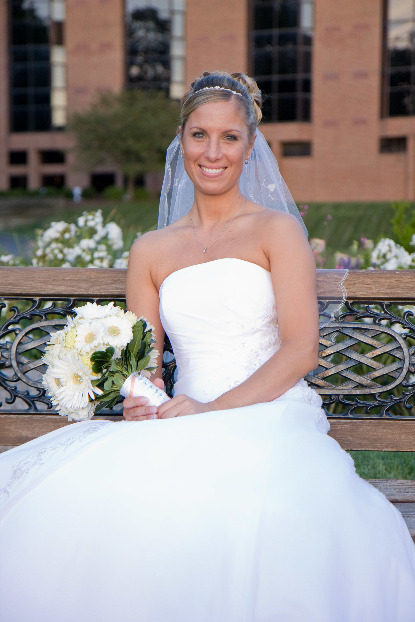 wedding photography bride on bench at woodcliff