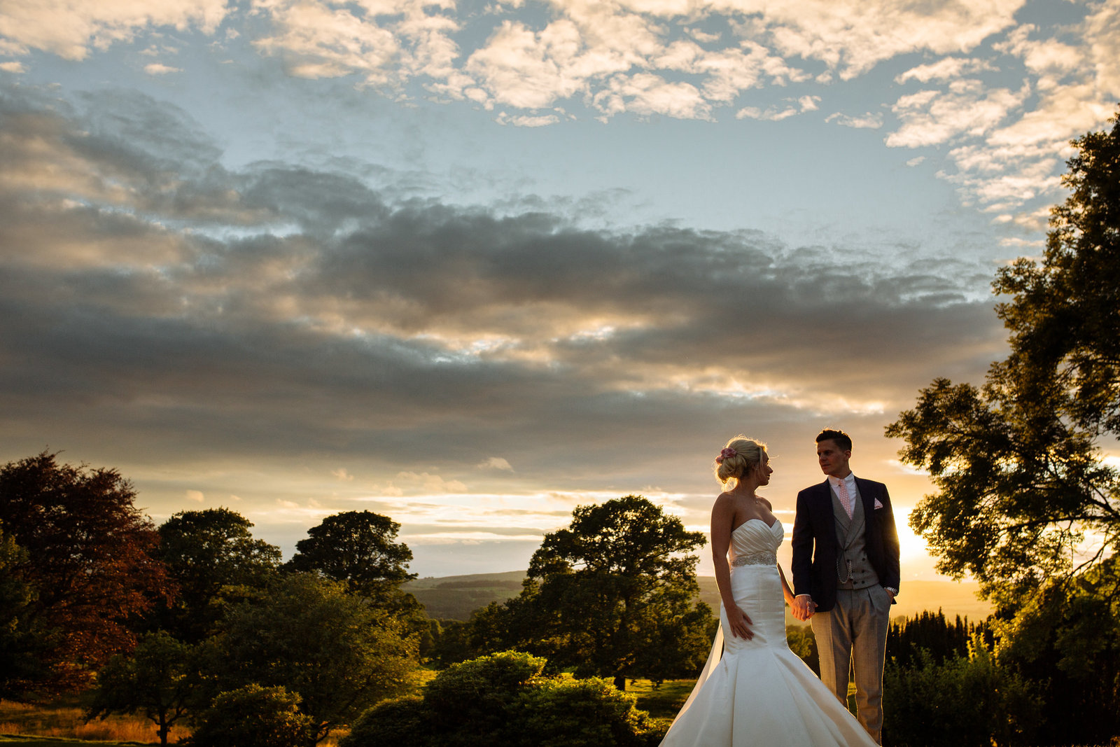Bride and groom at sunset at Whelprigg House. Modern wedding photographer