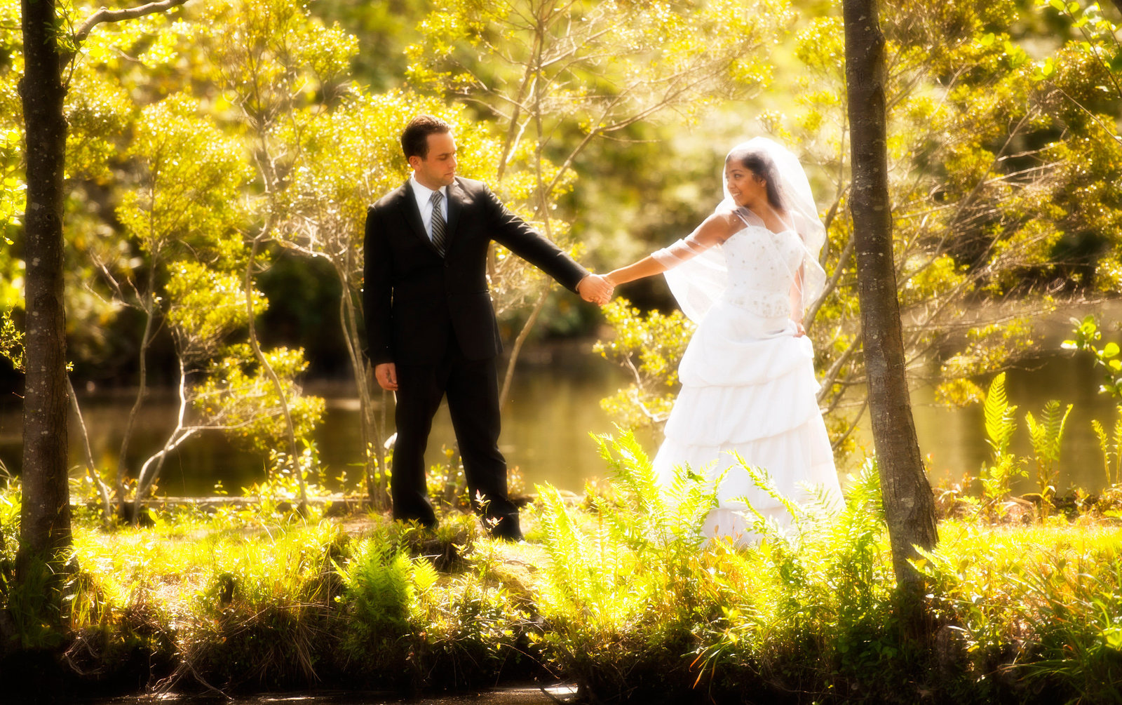 Groom is pulled along by his bride in Long Island, New York