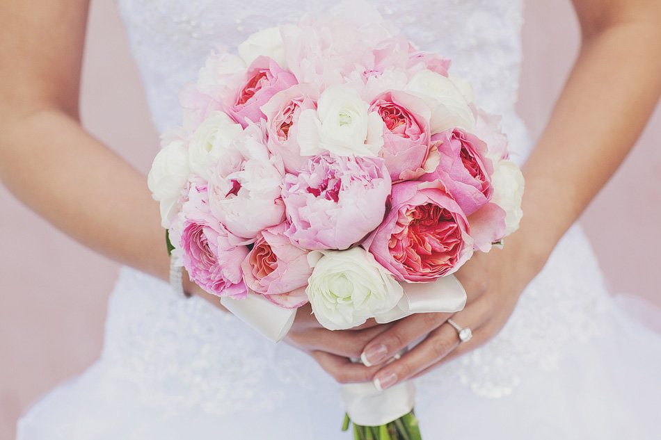Close up of pink peony wedding bouquet