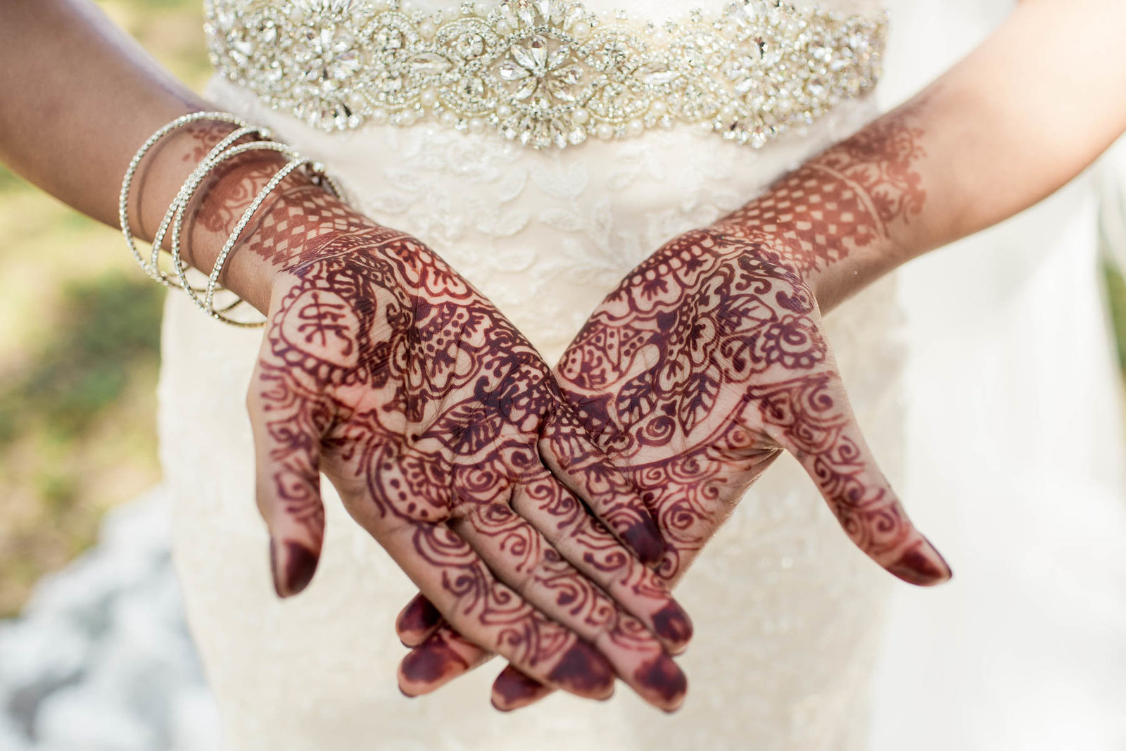Bride shows her hands designed with henna, White Point Garden, South Carolina