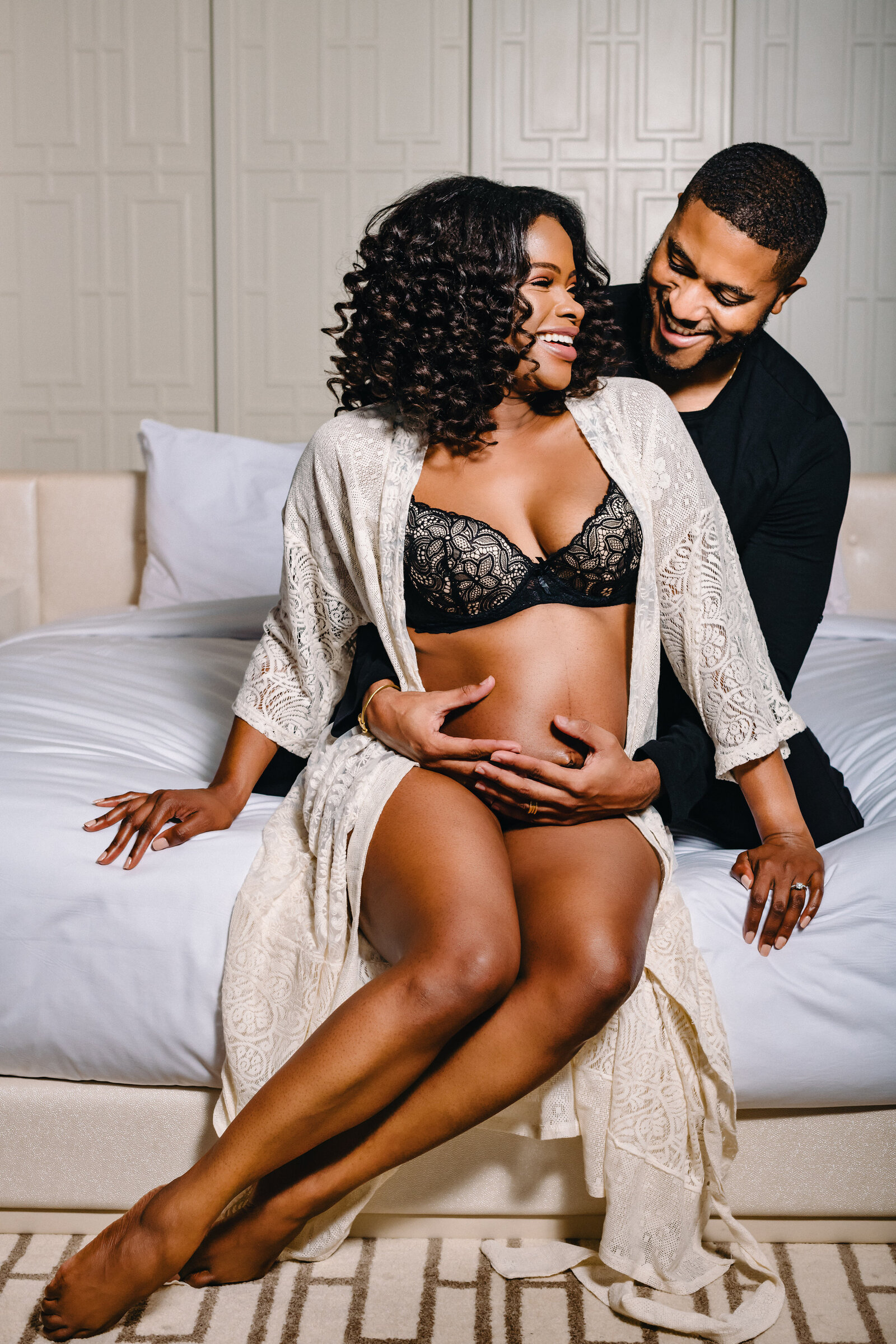 Smiling pregnant black woman with husband