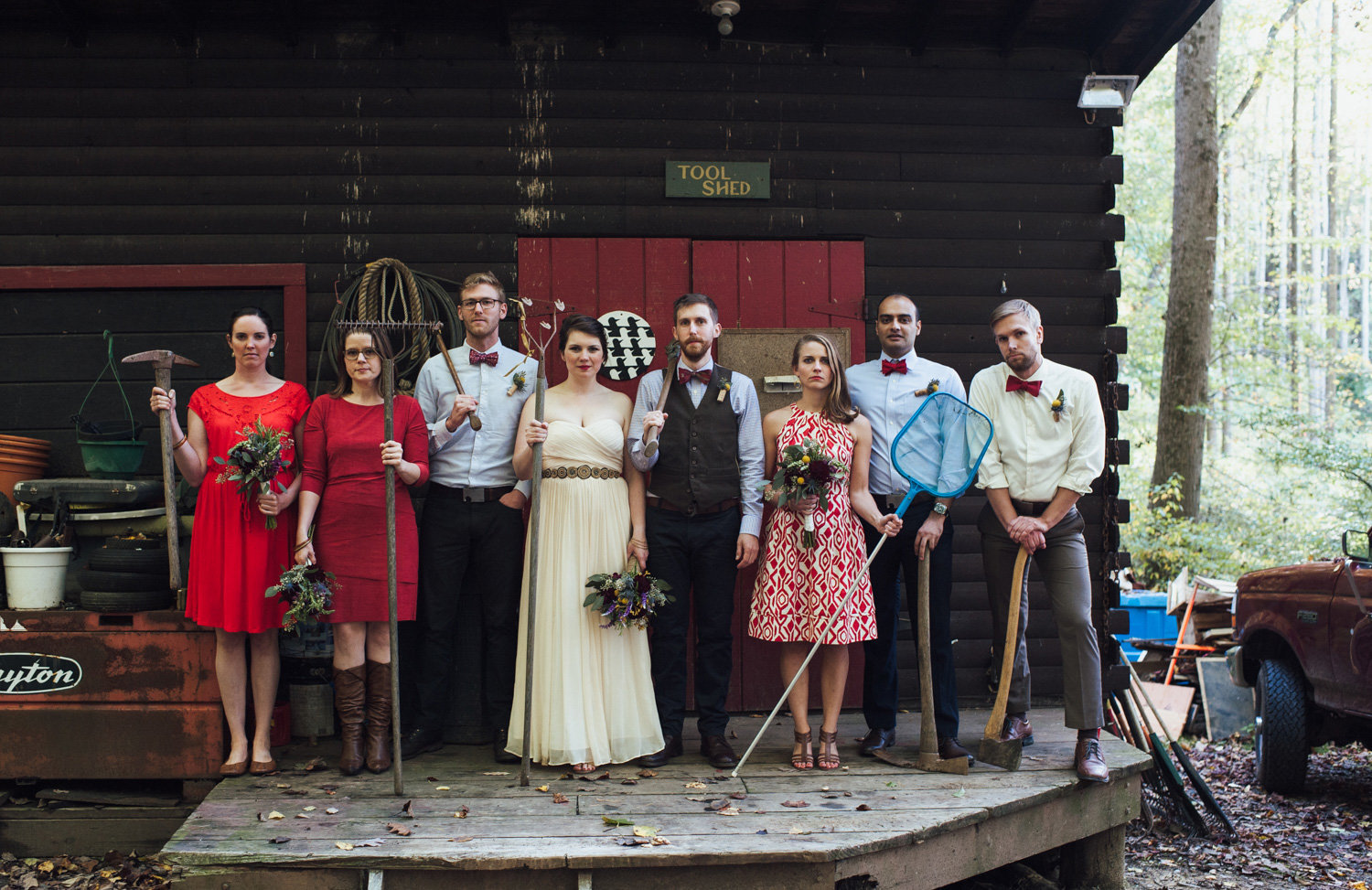Wedding party poses at a hipster barn wedding