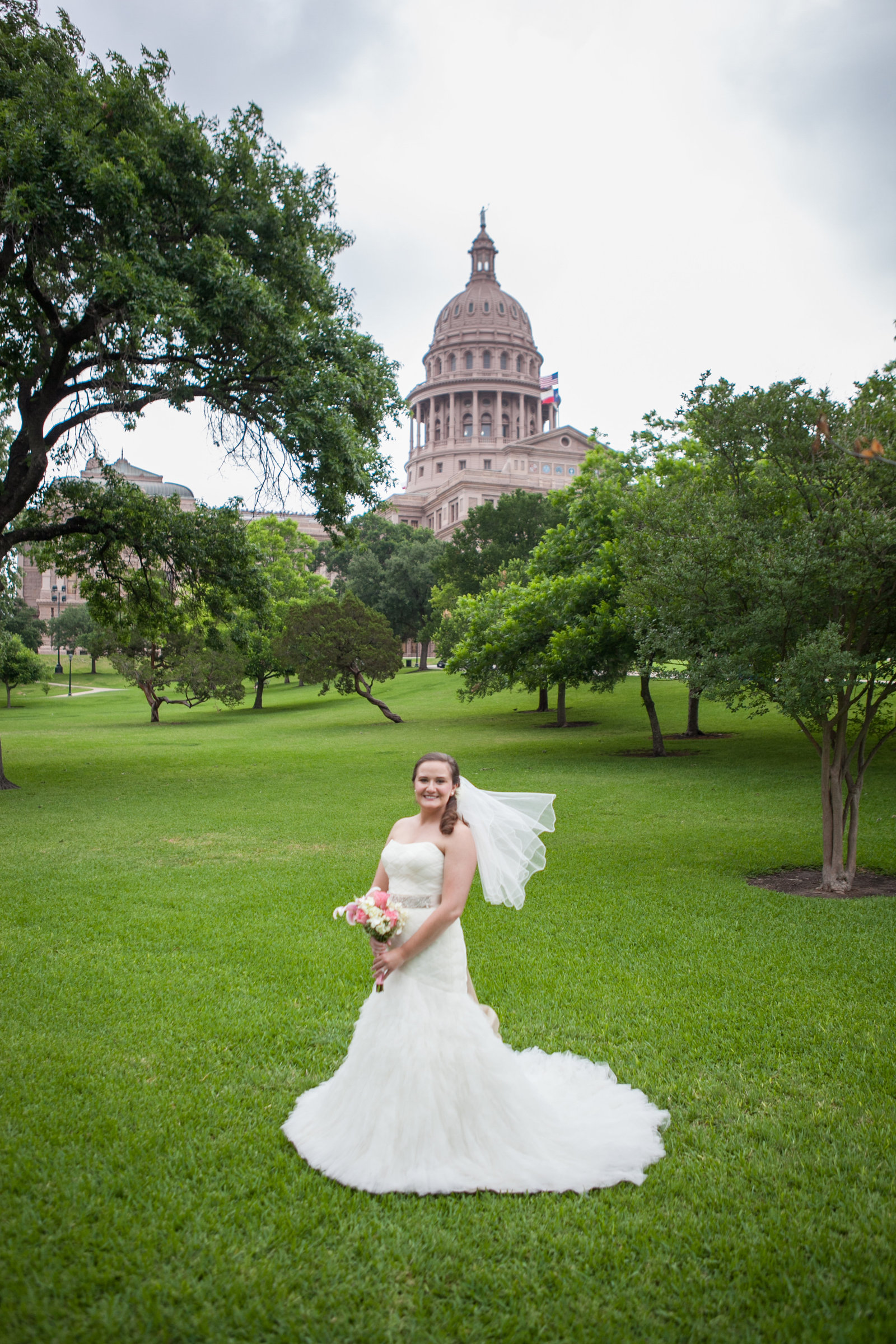 Austin Family Photographer, Tiffany Chapman, bride in front of capital on grass photo