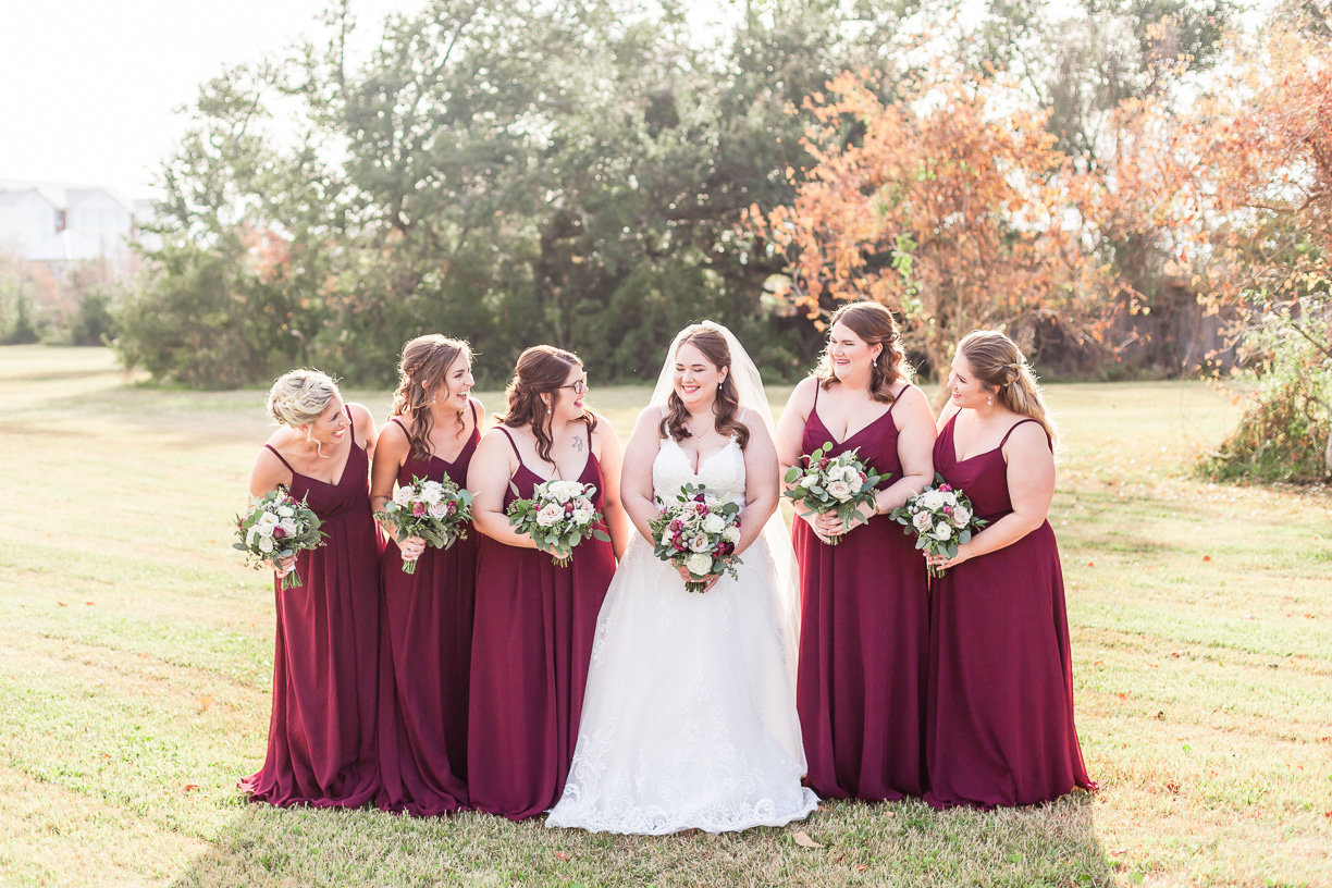 bridesmaids portraits with burgundy dresses by Toni Goodie Photography