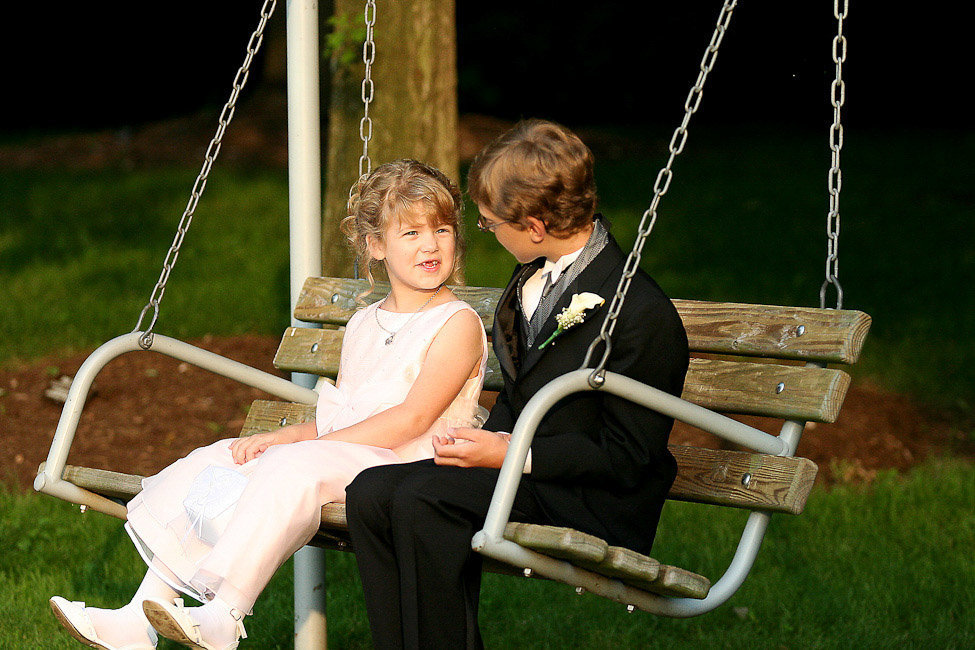 wedding photography flower girl and ring bearer on swing