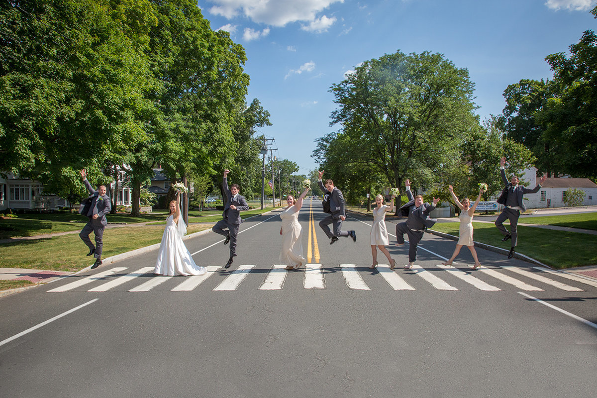 wedding party walking across like Abbey Road on crosswalk