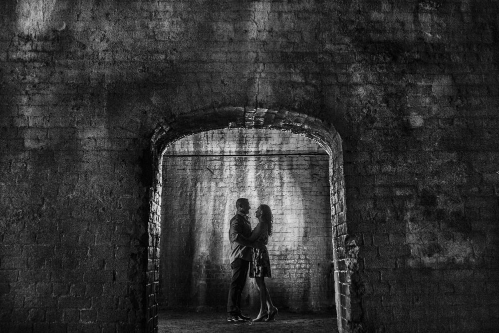 engagement portrait in the old river front walkways in savannah ga