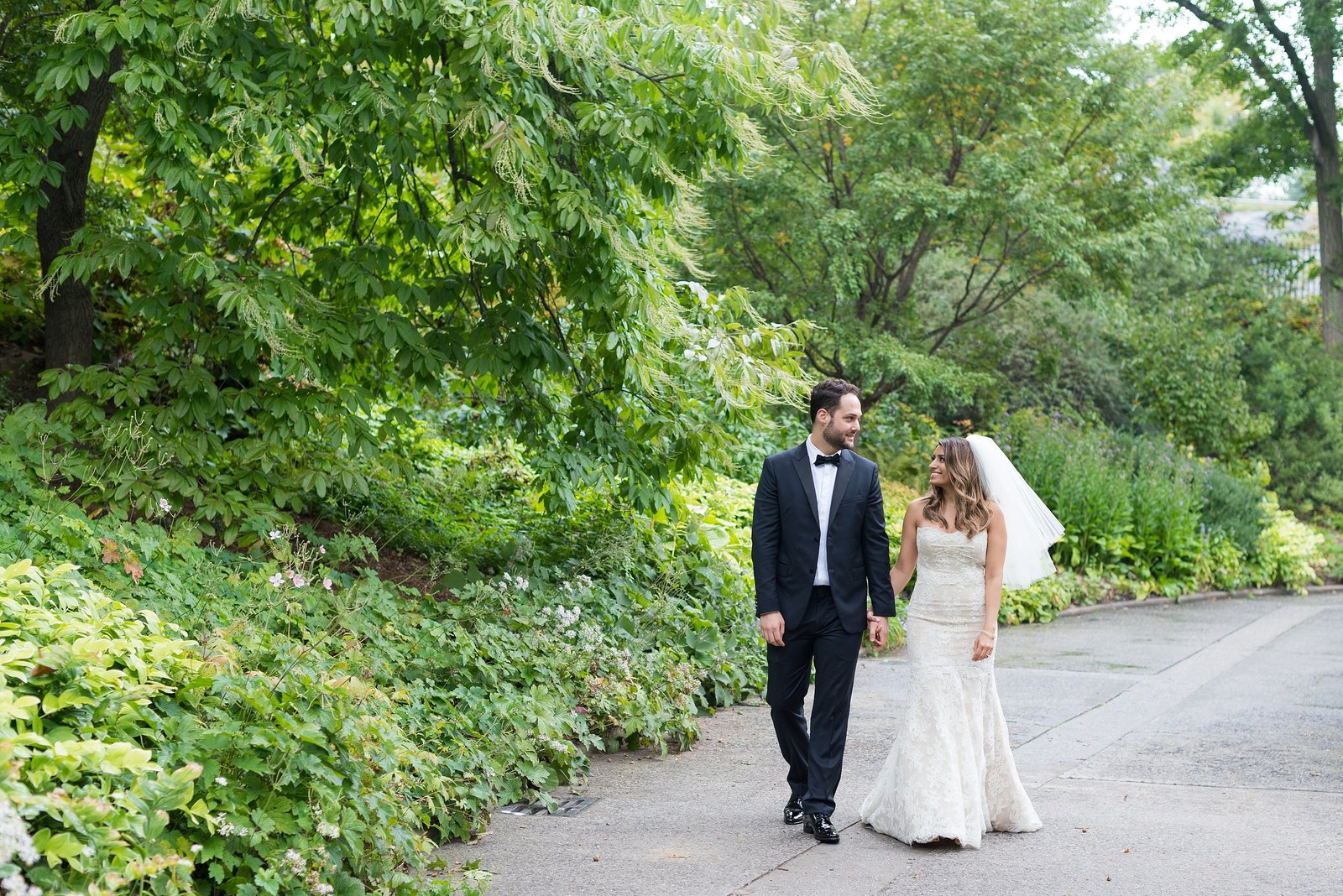 Bride and Groom looking at each other and walking at the Conservatory Garden in Central Park, New York City Photo