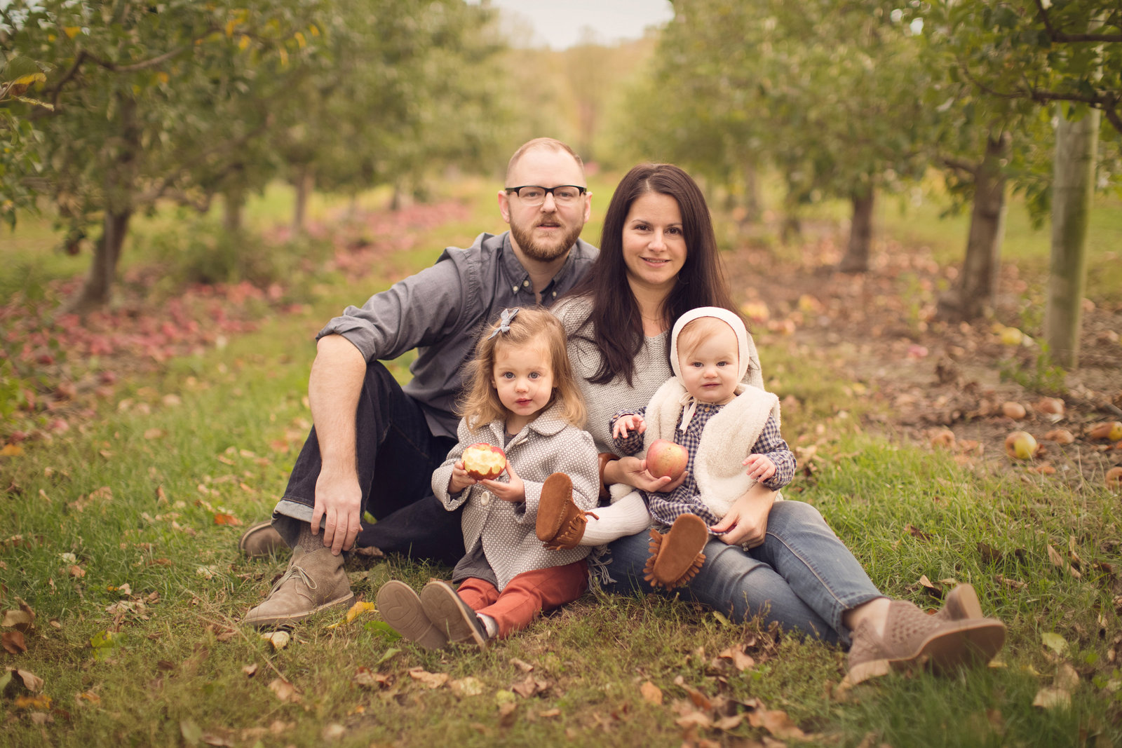 autumn family photo in apple orchard
