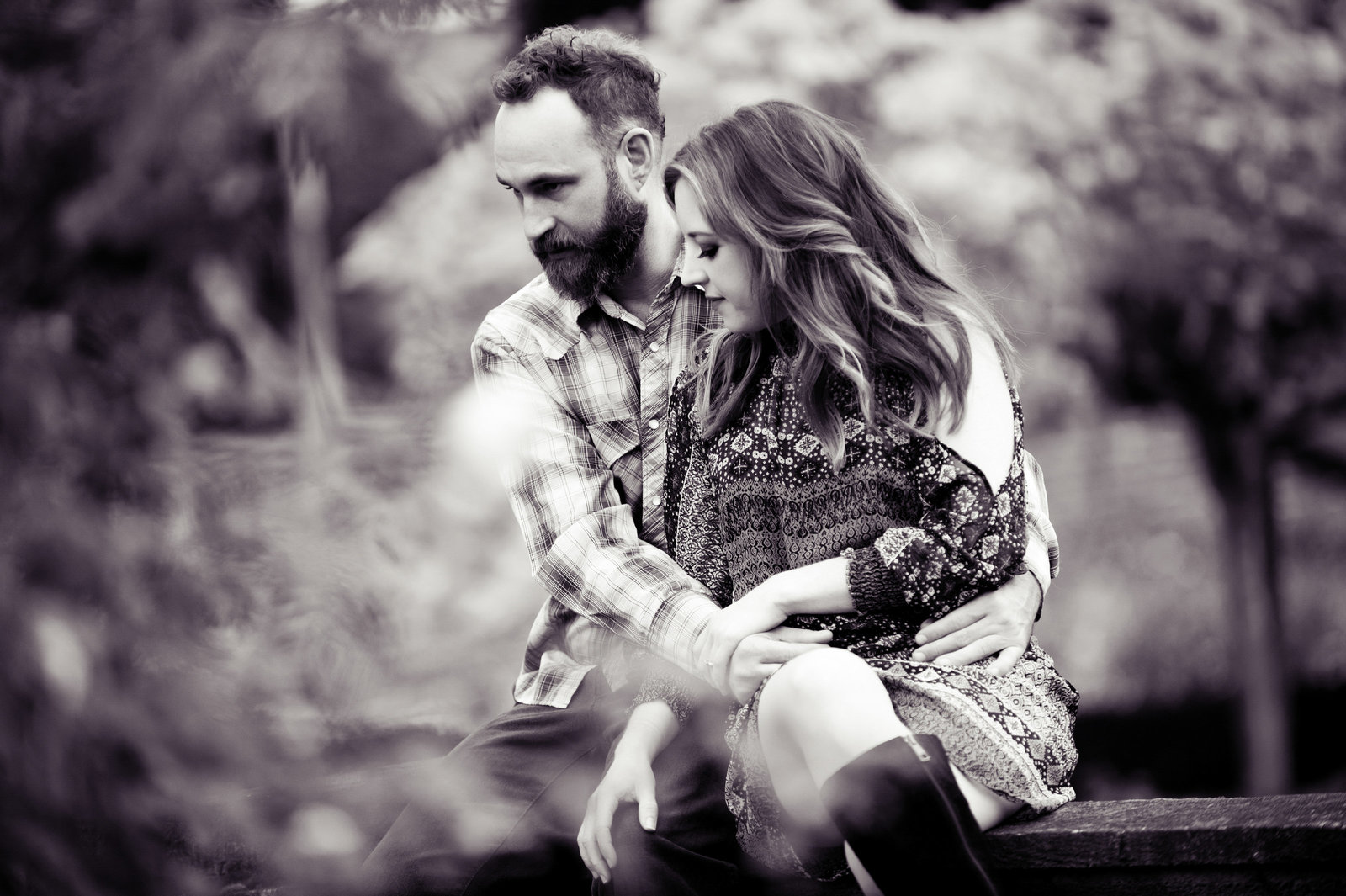 a pretty black and white  portrait of an engaged couple at peninsula park rose garden