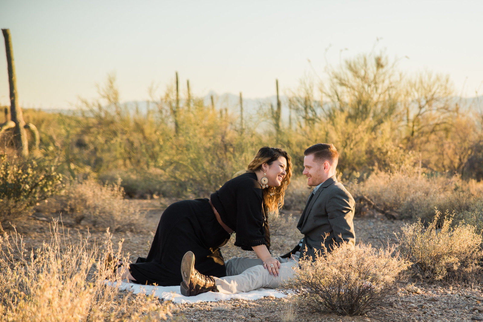 Gates Pass desert engagement session of couple playing