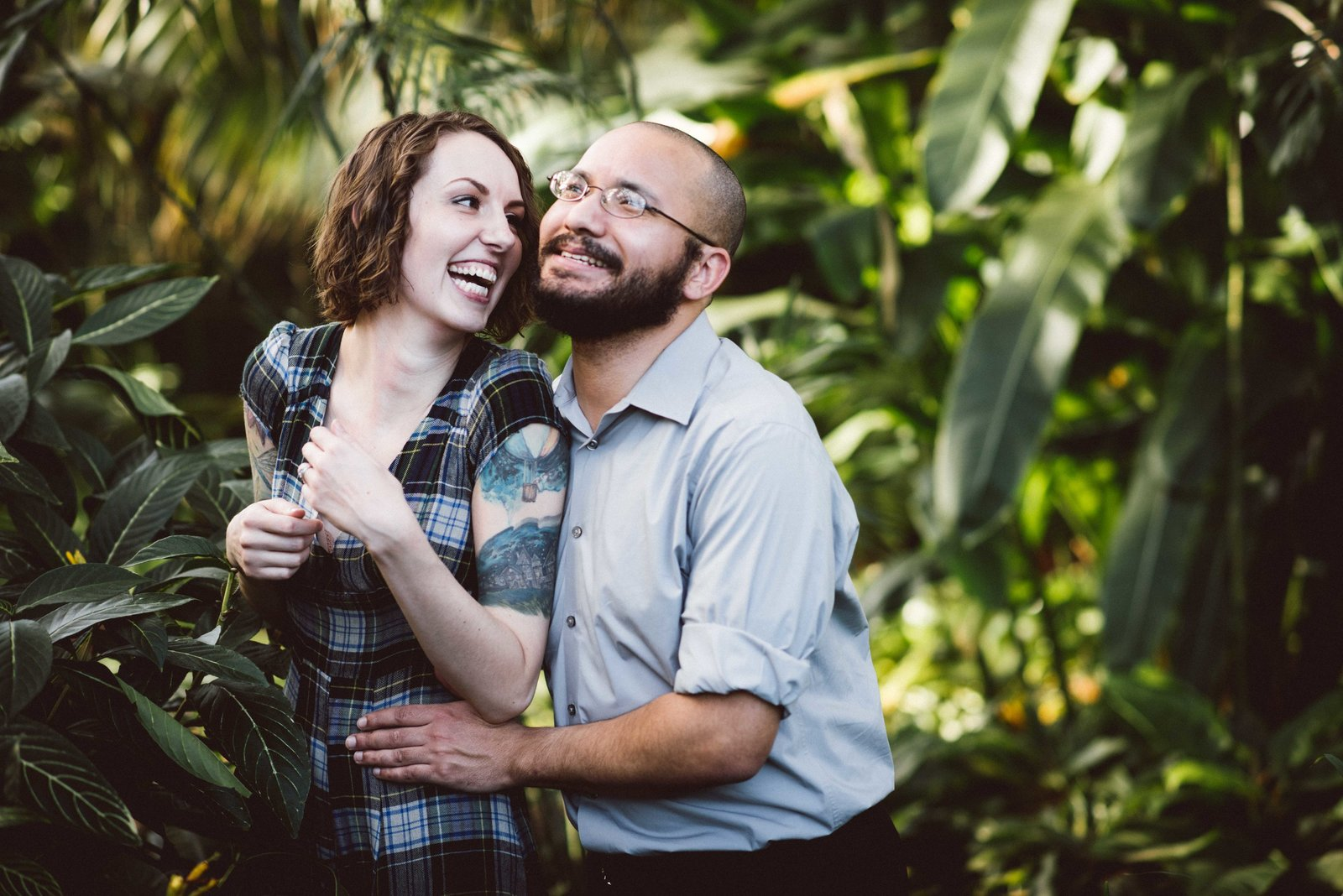 Engaged couple poses amongst foliage, Garfield Park Conservatory, Chicago.