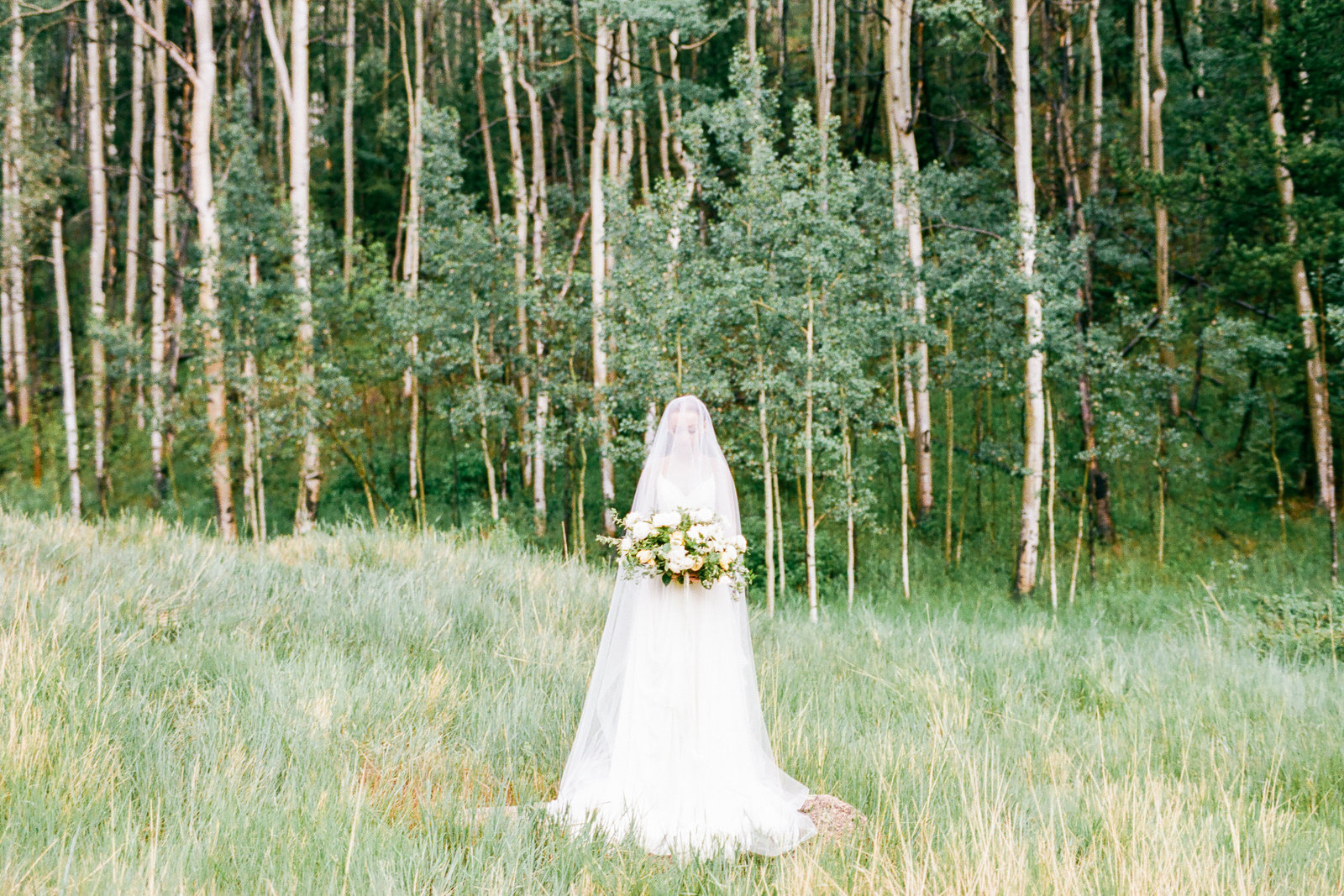 houston wedding photographer in colorado for abby's bridal portraits with layers of loverly and lovely bride dress from leanne marshall