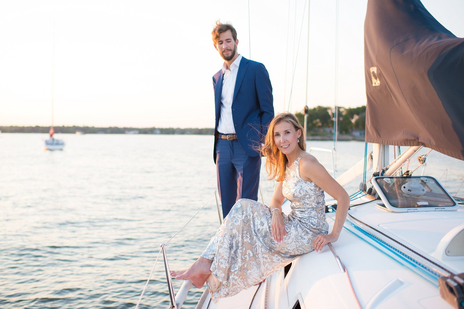 Bride and Groom on sailboat and water during sunset at The American Yacht Club in Rye, New York Photo