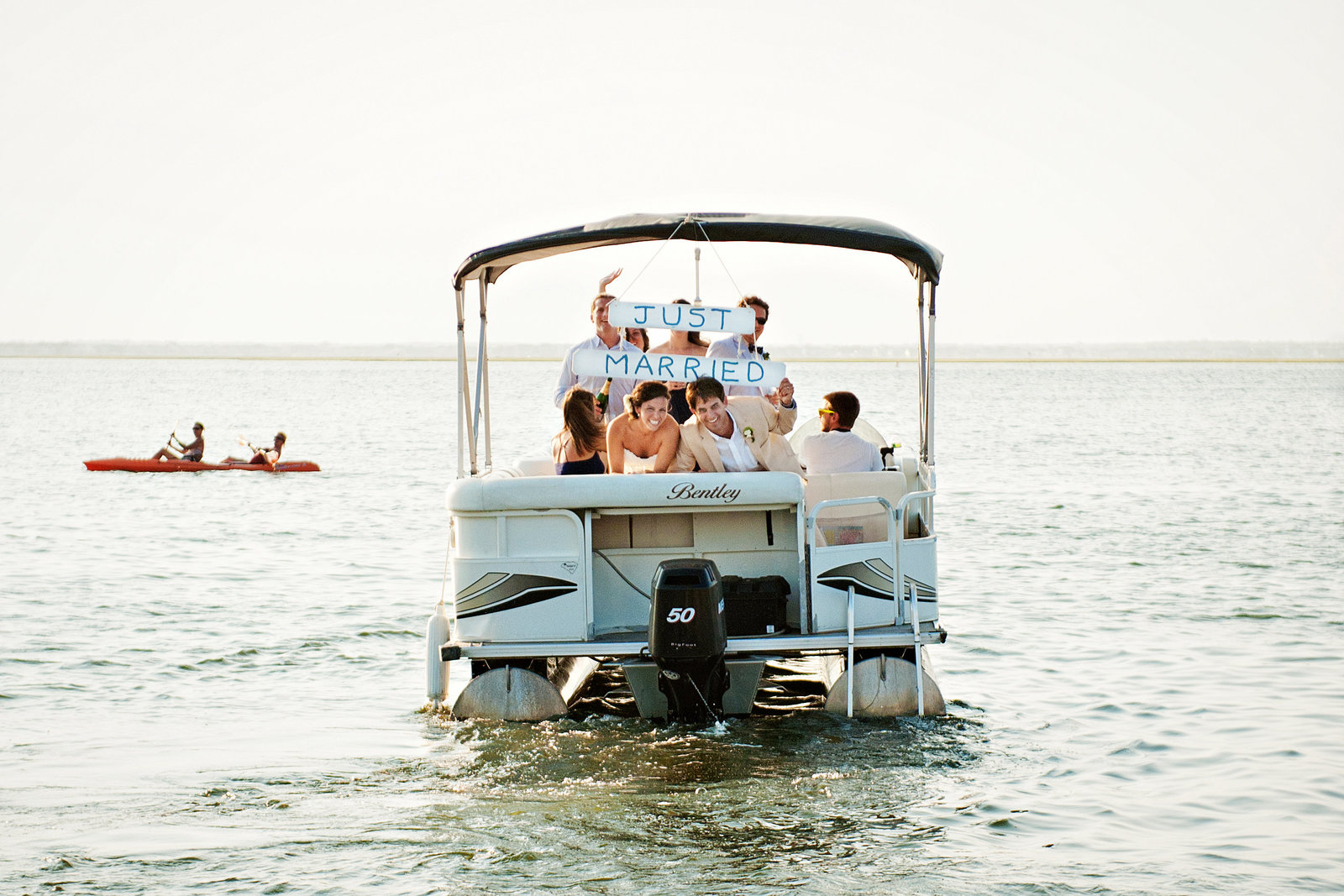 A newly married couple hop a boat after the ceremony on Long Beach Island, NJ.